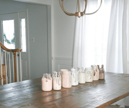 white room with wood table and painted jars