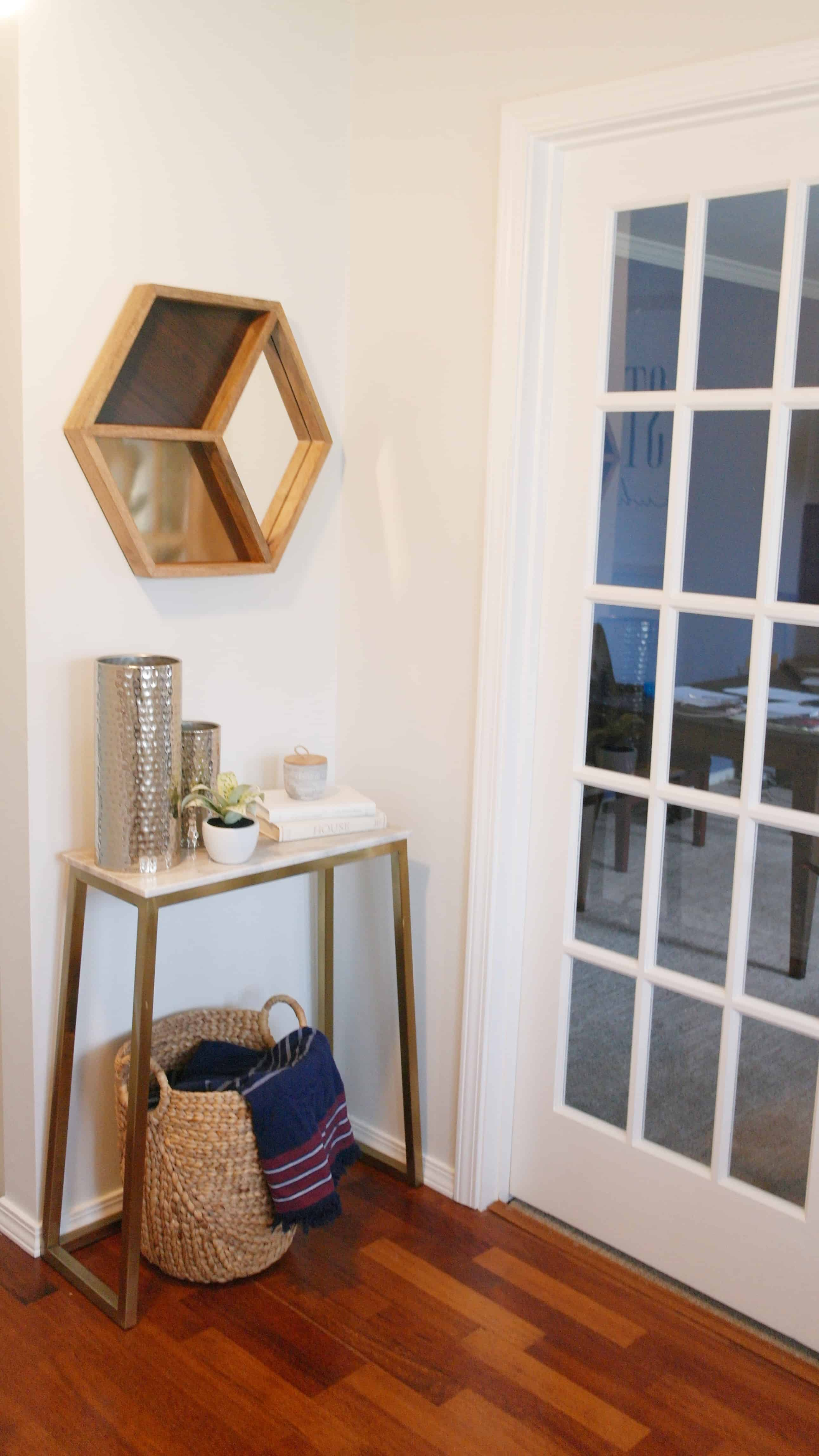 small gold entry way table with modern decor