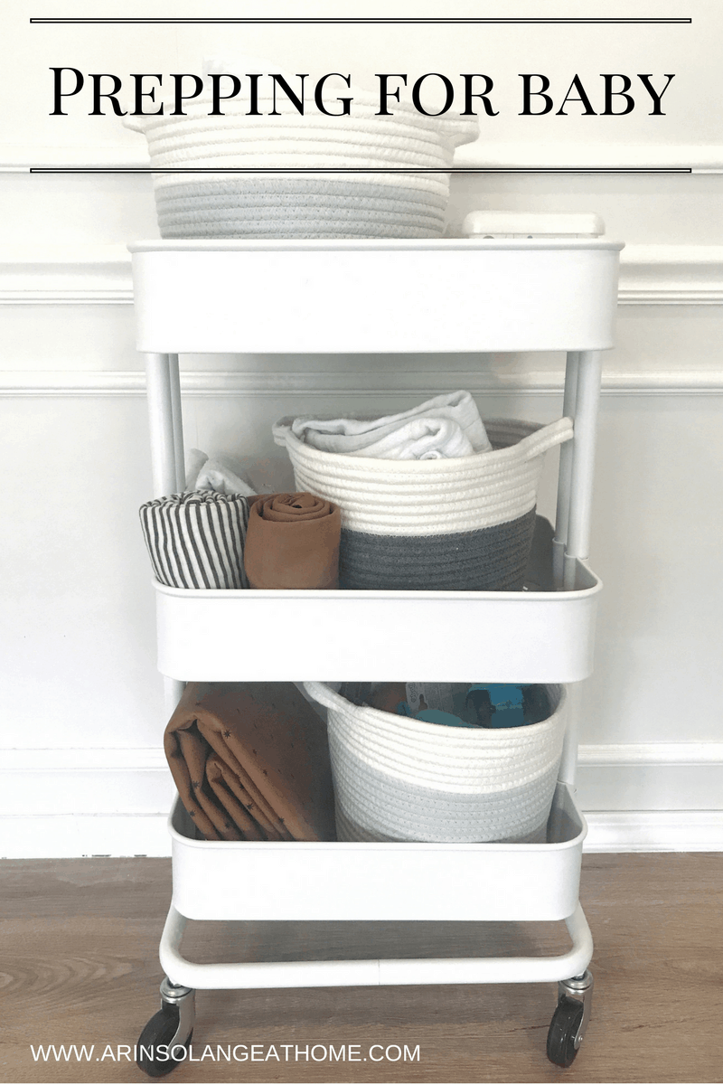 white Ikea cart with baskets and blankets | Prepping for Baby