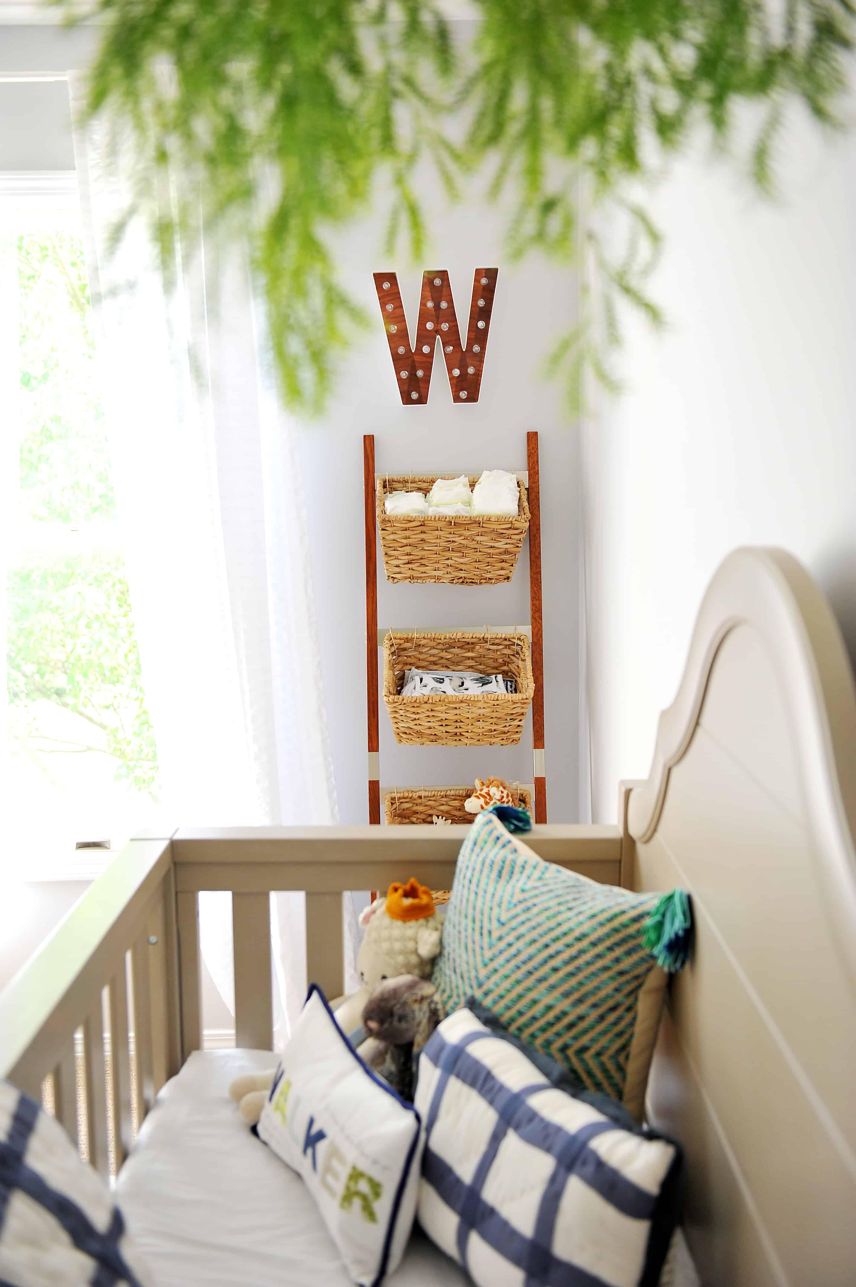 wicker ladder in modern baby boy nursery
