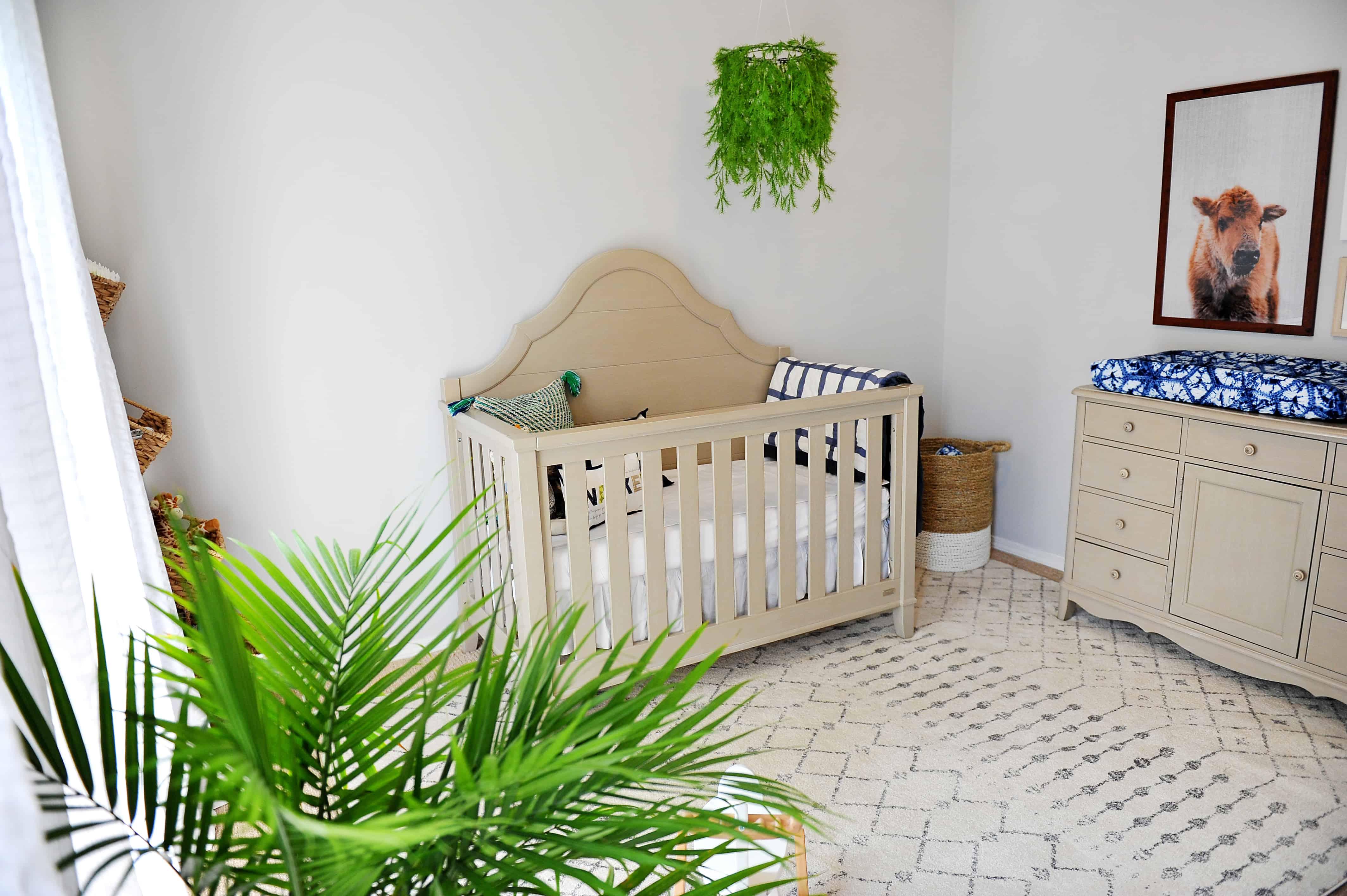 nursery with buffalo print and greenery