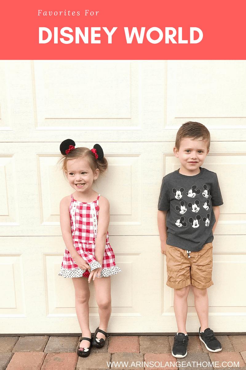 two kids dressed in Disney outfits against garage door