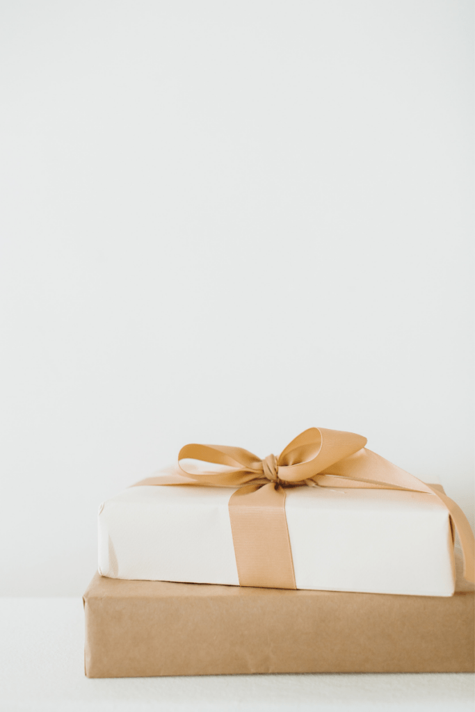 white backdrop with neutral gifts