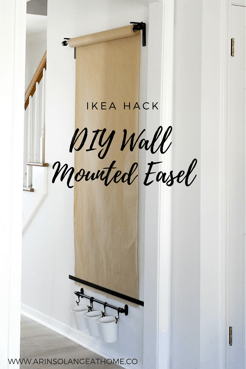 A wall mounted easel roll on a wall. An Ikea Hack to DIY your very own Wall Mounted Easel.