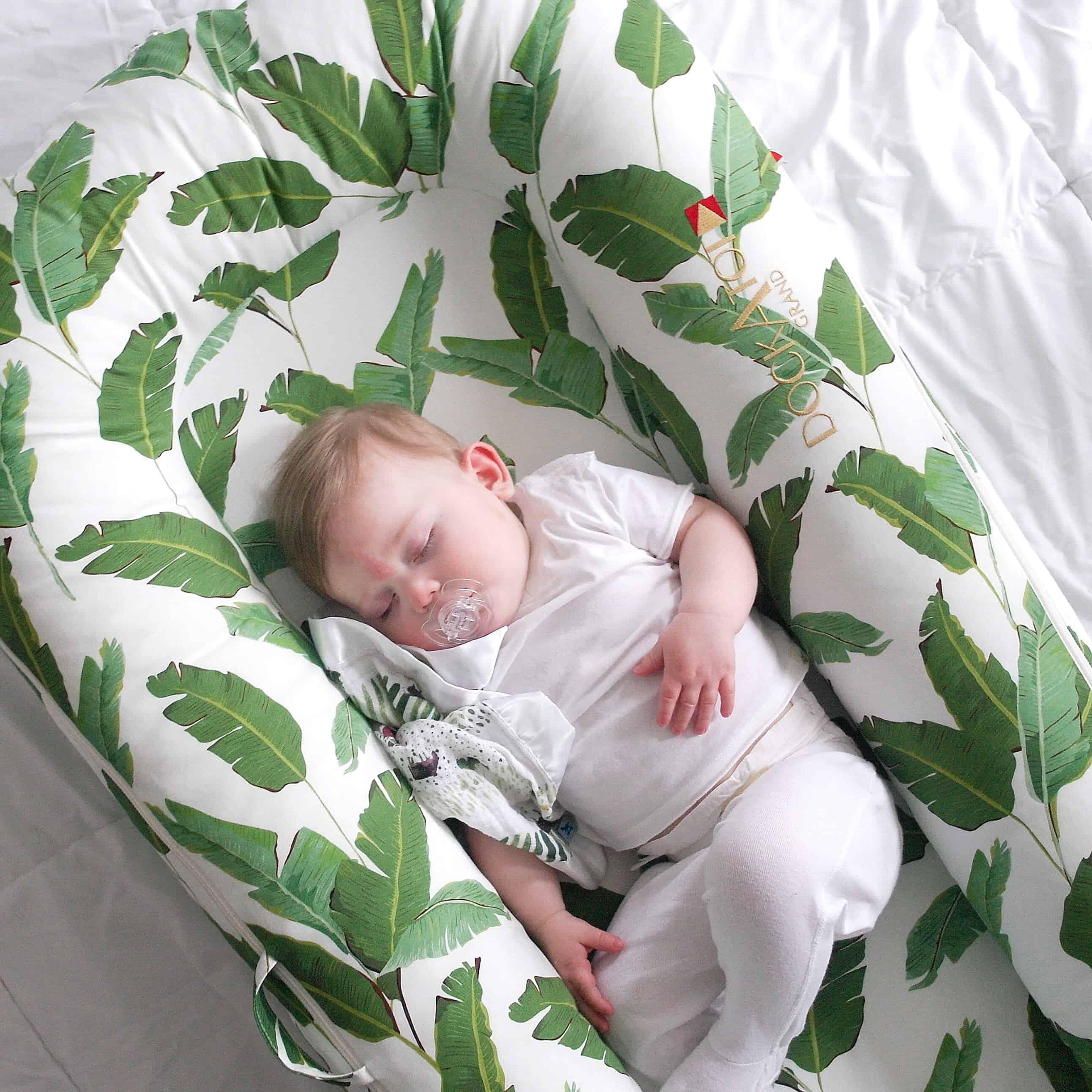 baby sleeping in dock a tot grand