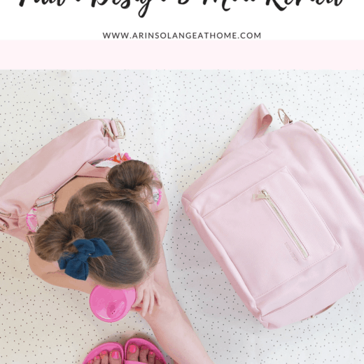 little girl with pink fawn design bag and blush fawn design diaper bag
