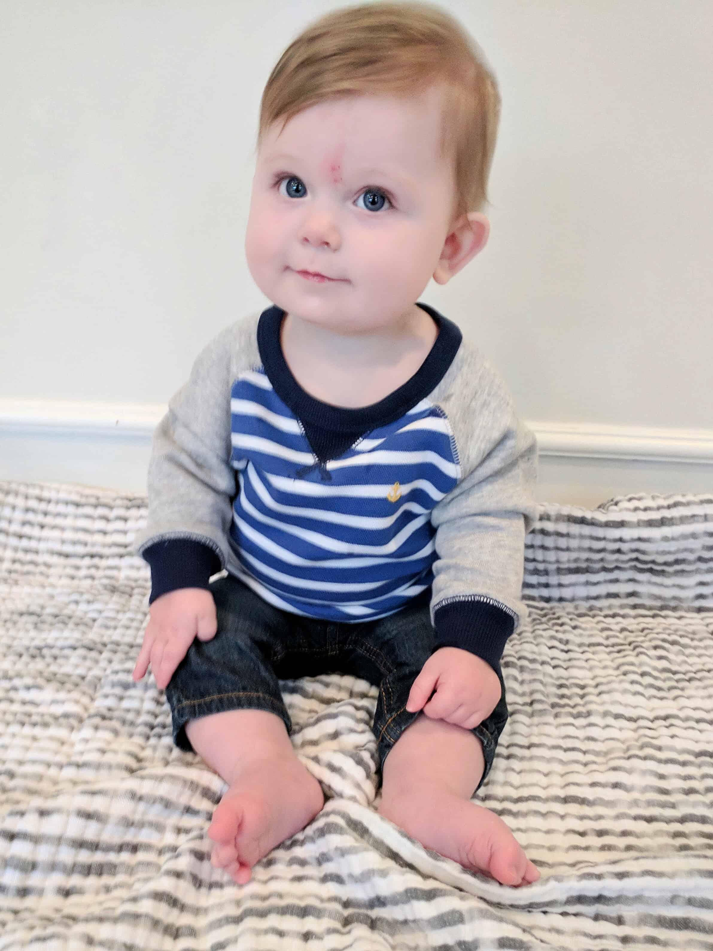 Baby boy in blue striped sweatshirt