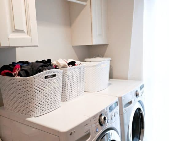 white washer and dryer with white laundry baskets
