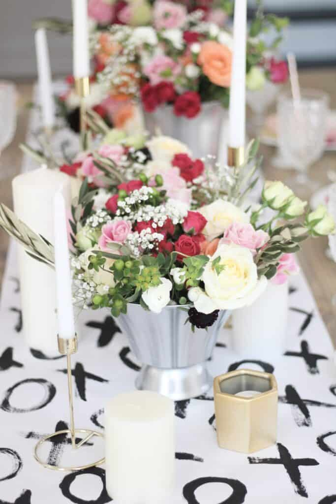 xoxo table runner with floral arrangements