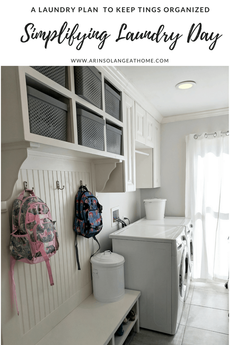 laundry room with pottery barn backpacks and white bins | Simplifying Laundry Day