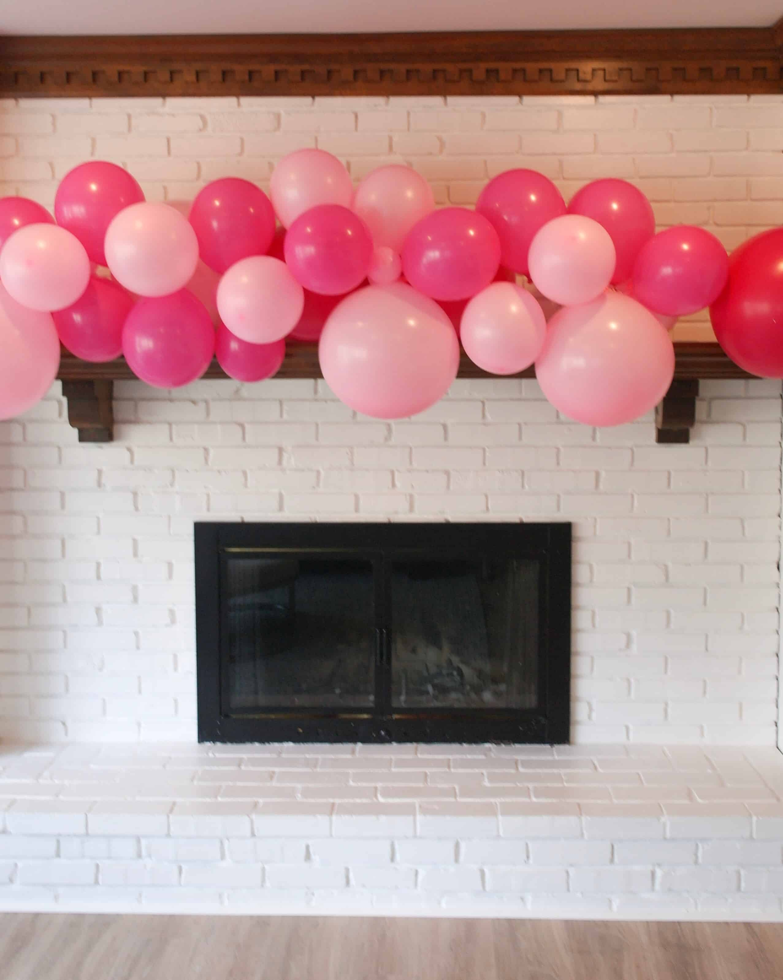white brick mantle with pink balloons | Valentines Day Party