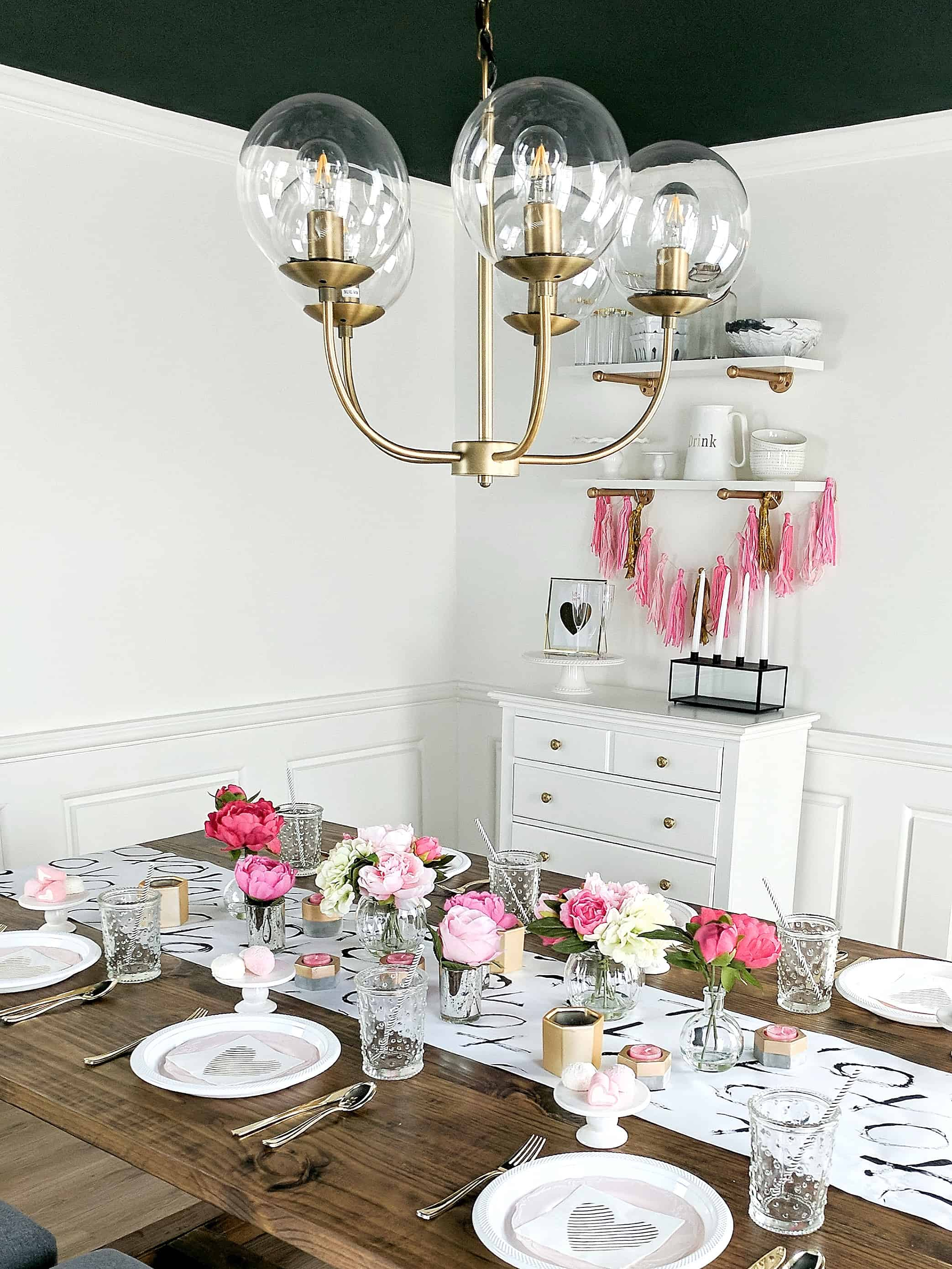 white room with gold chandelier and floral tablesetting - Valentine's Day Party