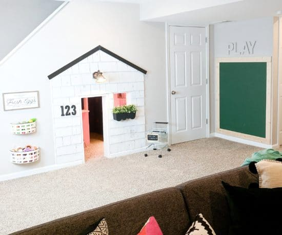 playroom with house and chalkboard wall