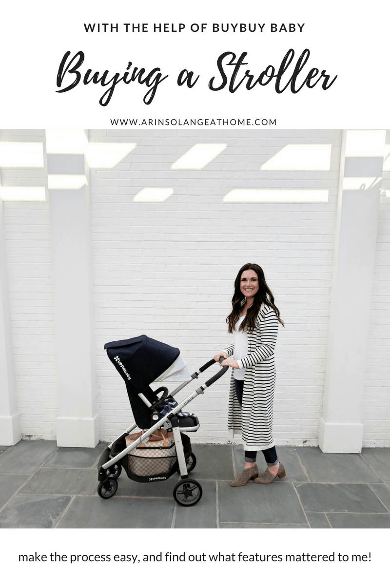 mom pushing an UPPAbaby cruz stroller by white wall | Buying a Stroller