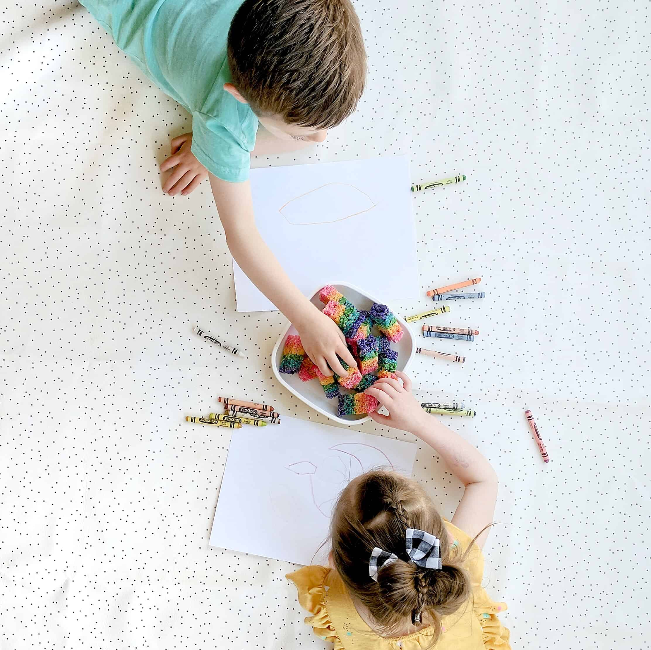 kids playing and coloring on white mat
