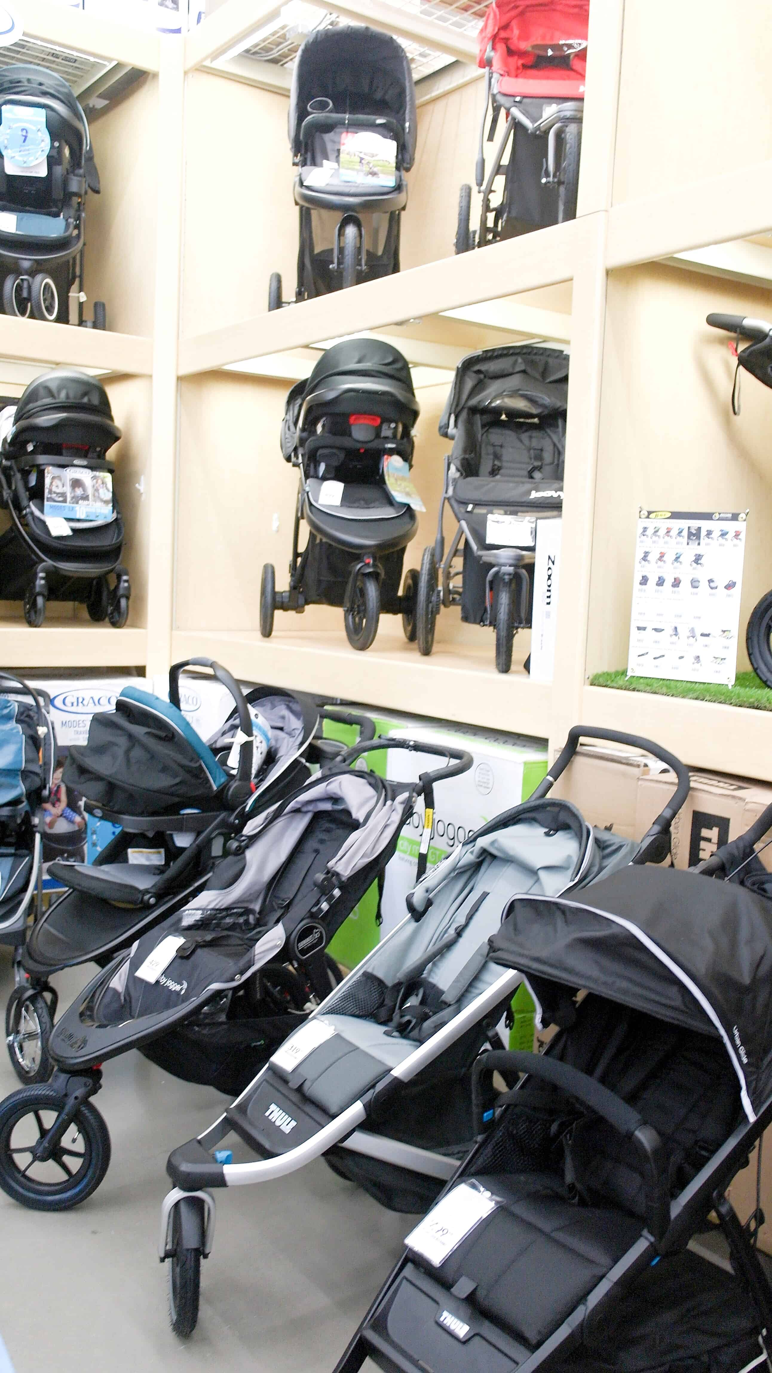 strollers on shelves at BuyBuy Baby | Buying a Stroller