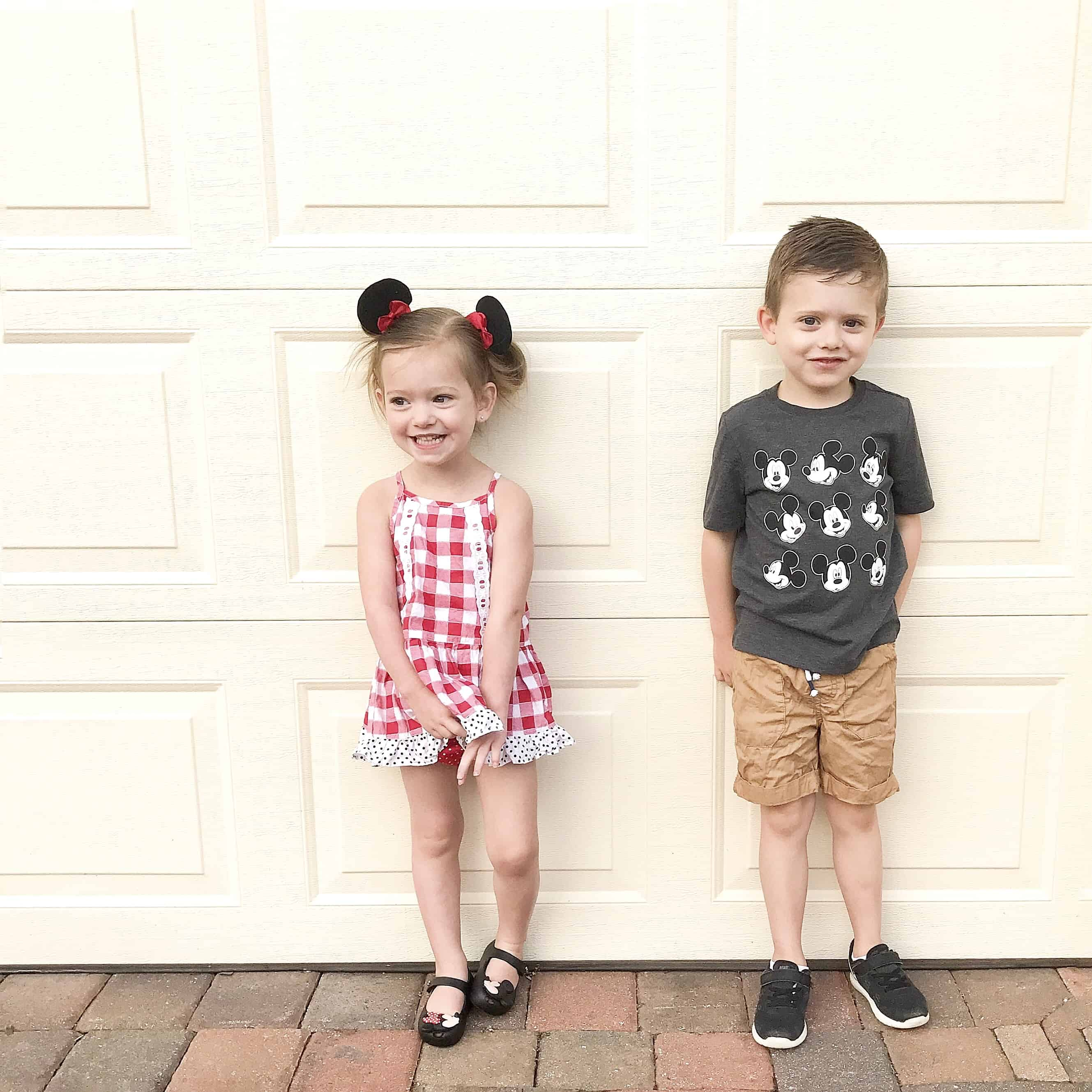 two kids dressed for Disney clothes