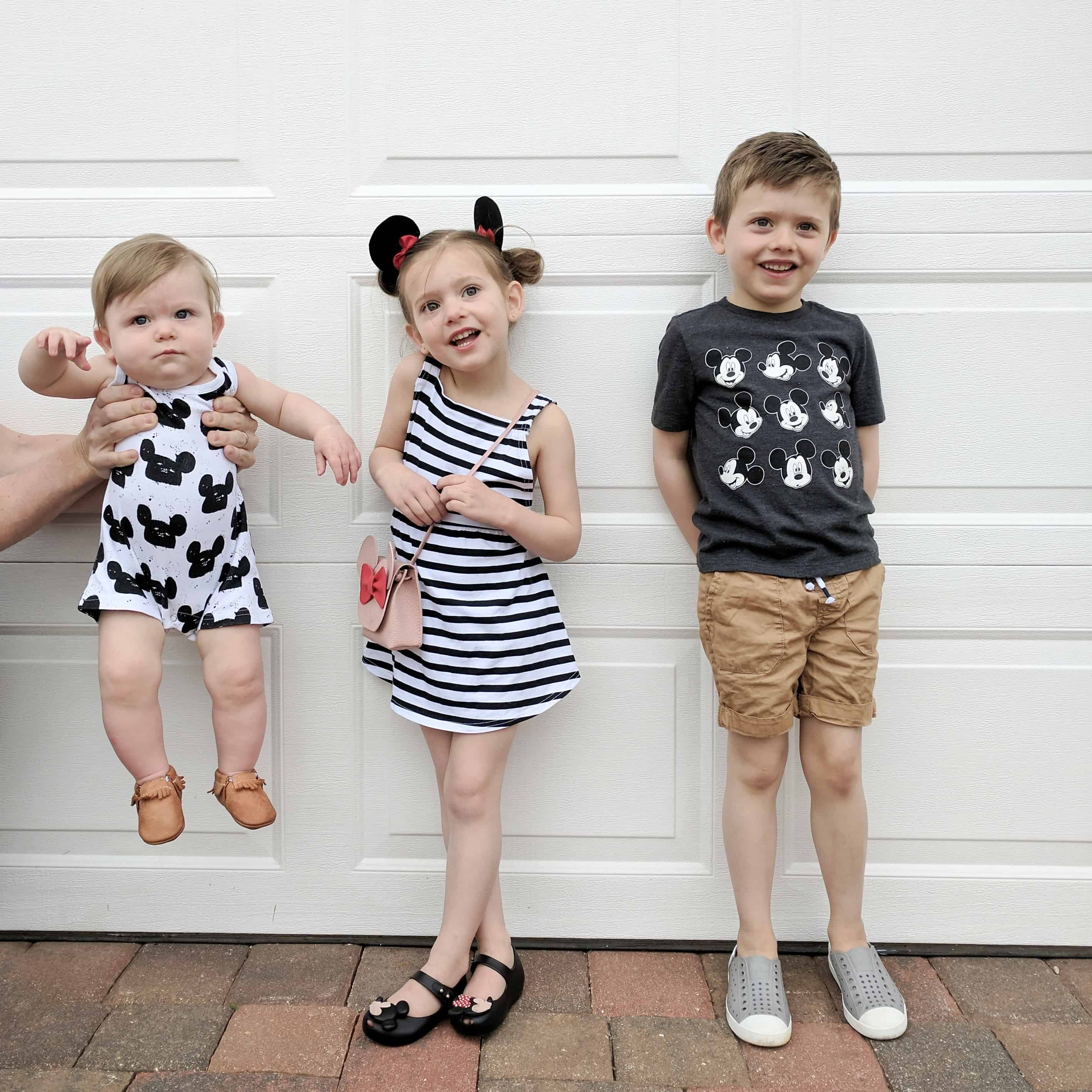 three kids in Disney outfits June and January and modern burlap