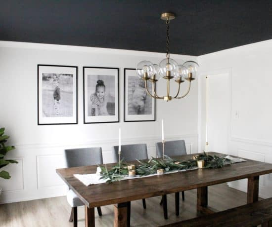 dining room with dark ceiling and large black and white prints