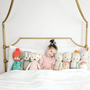 cuddle and kind dolls all lined up
