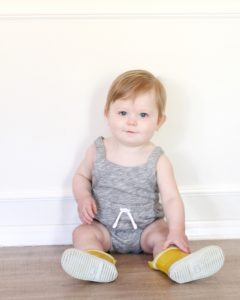 baby boy in rainbows and romper