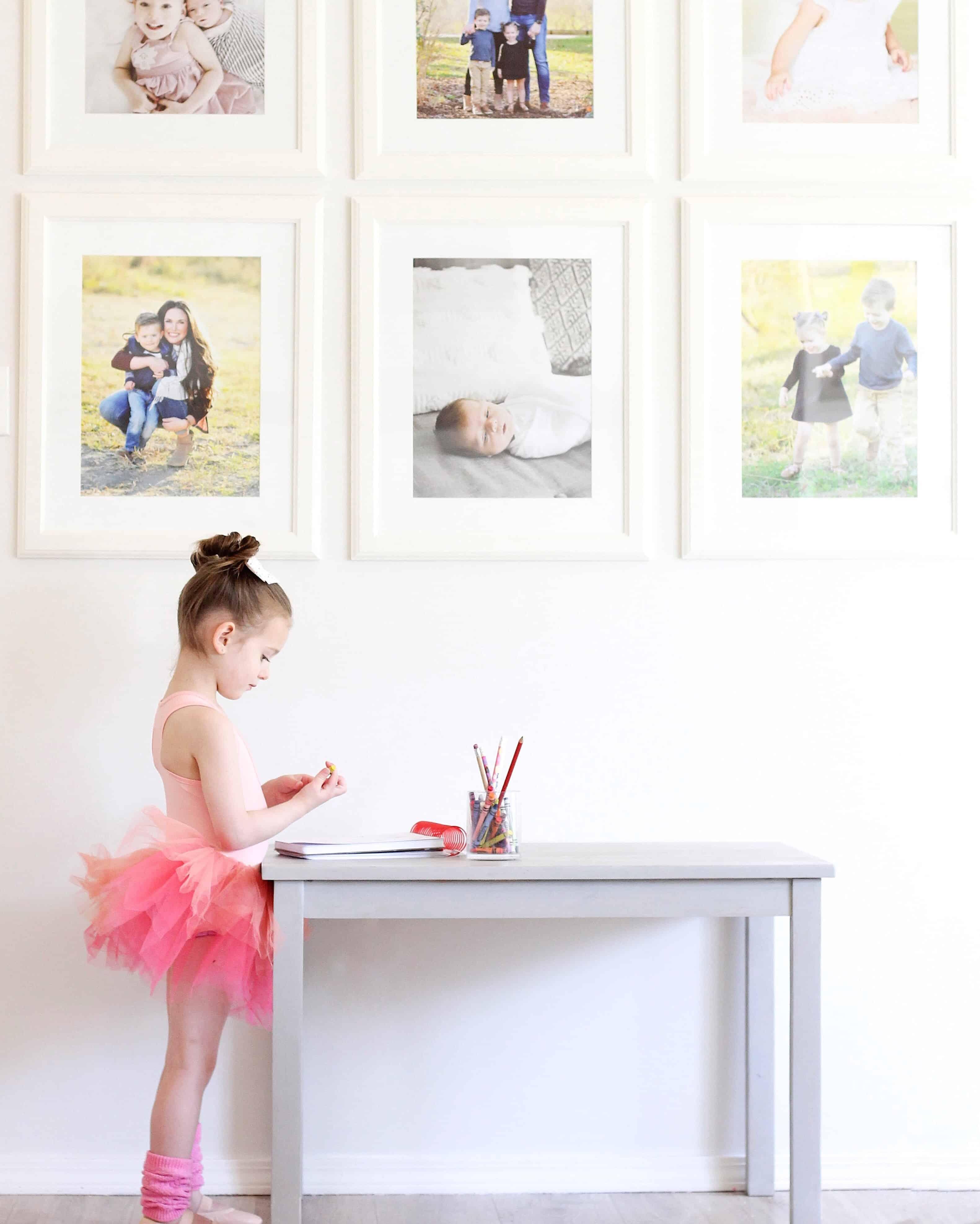 toddler girl at table wearing plum tutu
