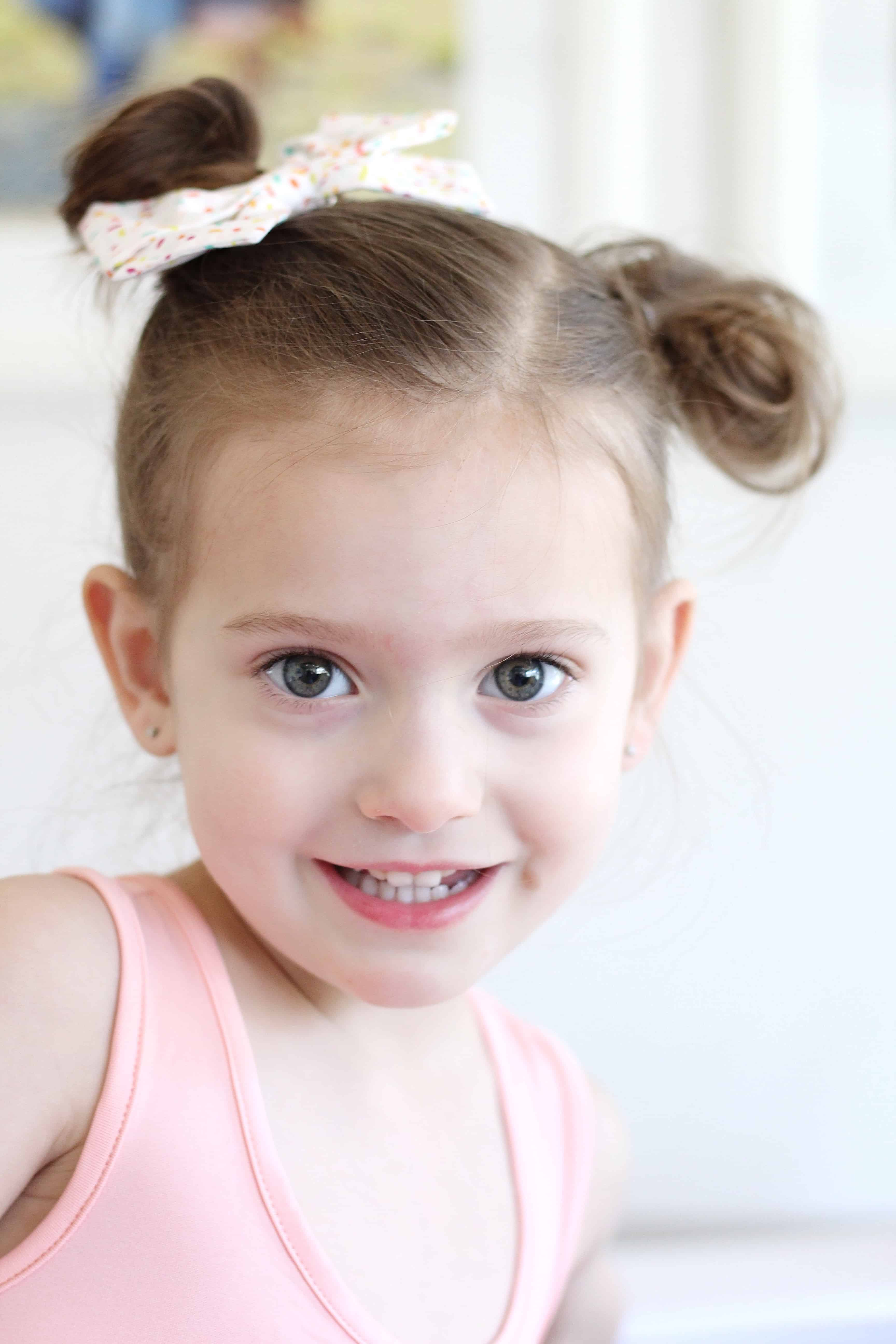 toddler girl with pigtail buns