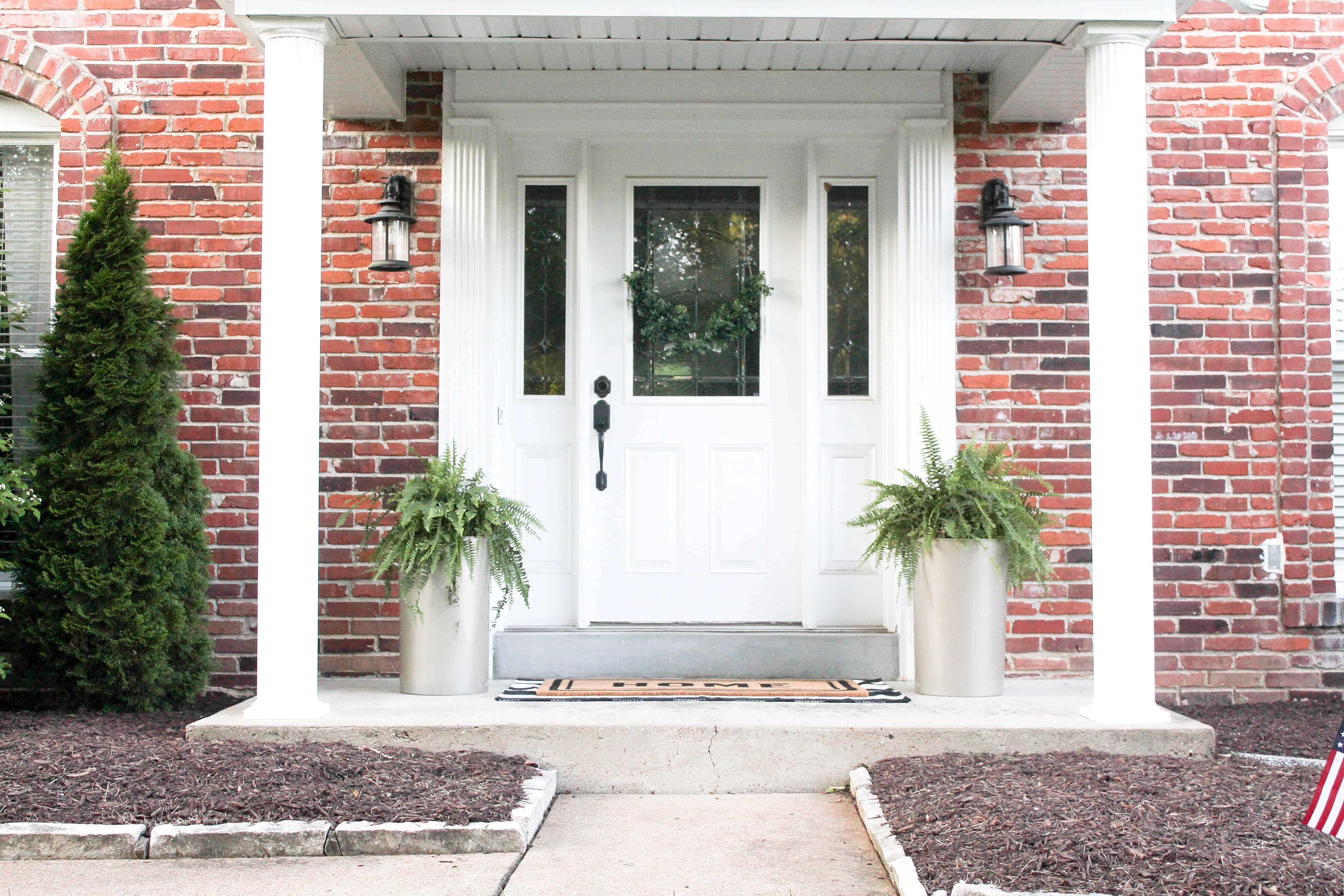 front porch with large gold planters | Trash Can Planter Hack