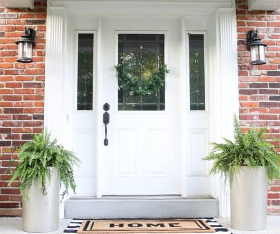 front porch with large gold planters