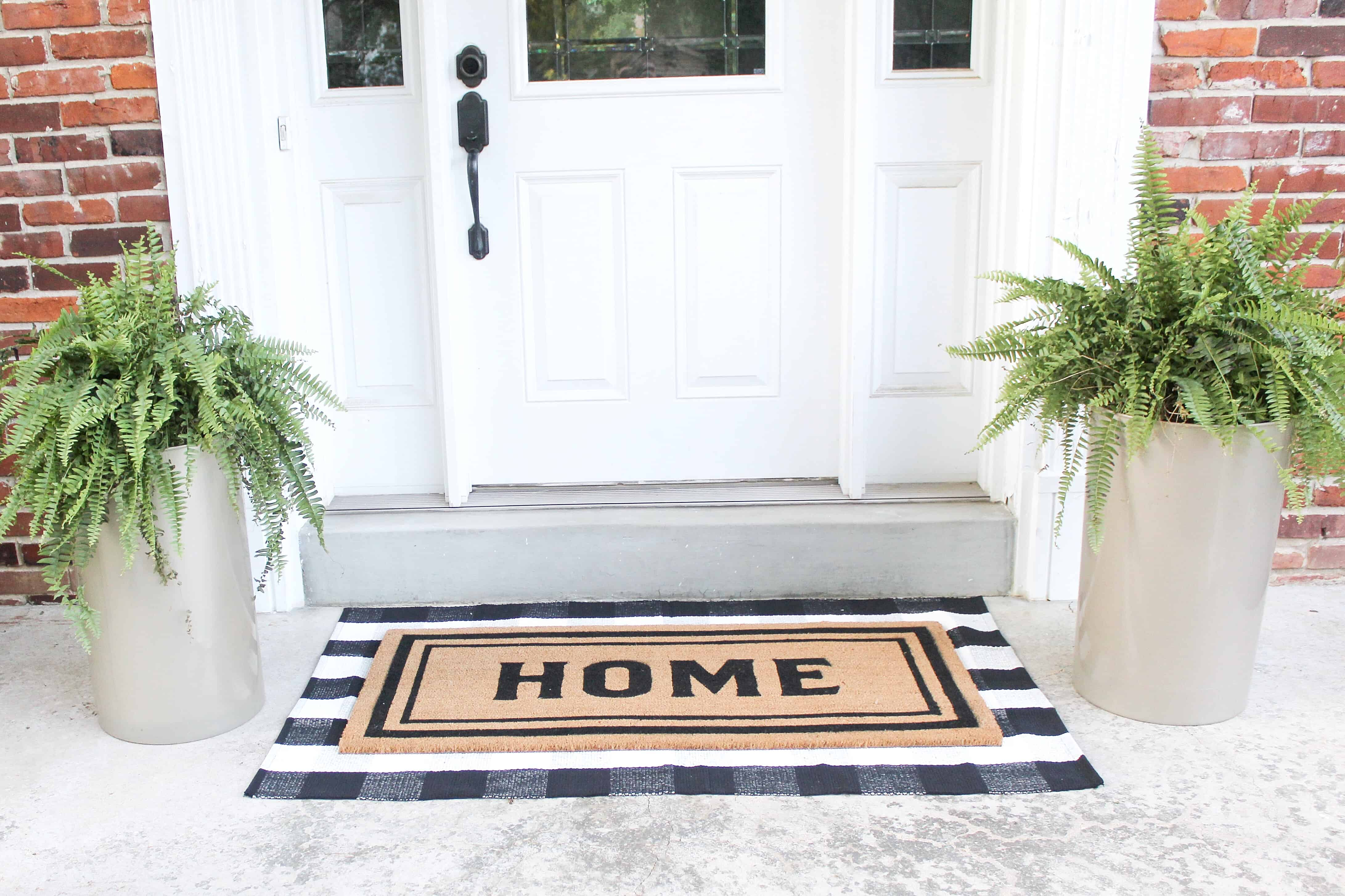 front patio with layered rugs | Trash Can Planter Hack