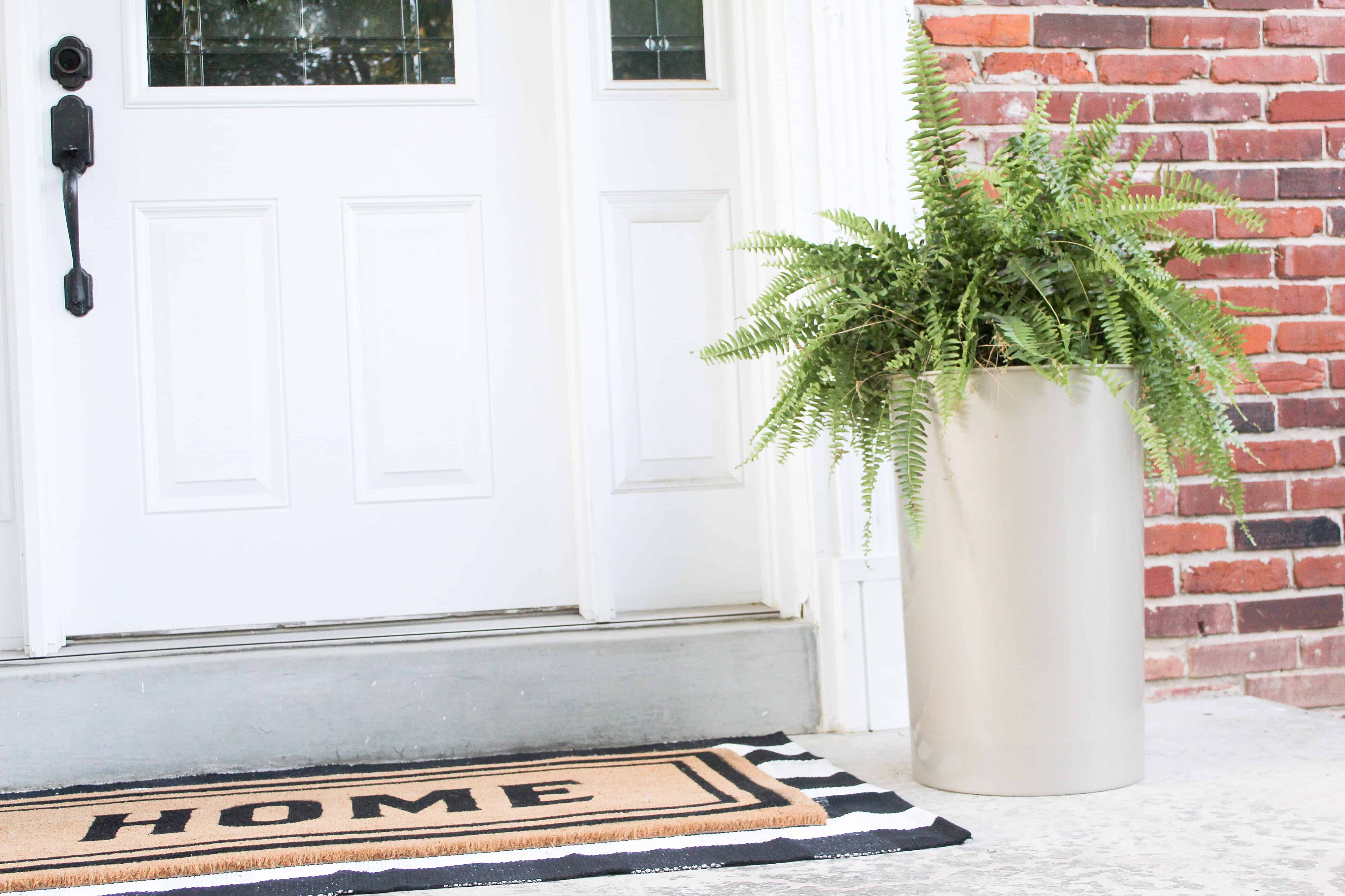large gold planter and layered rugs | Trash Can Planter Hack