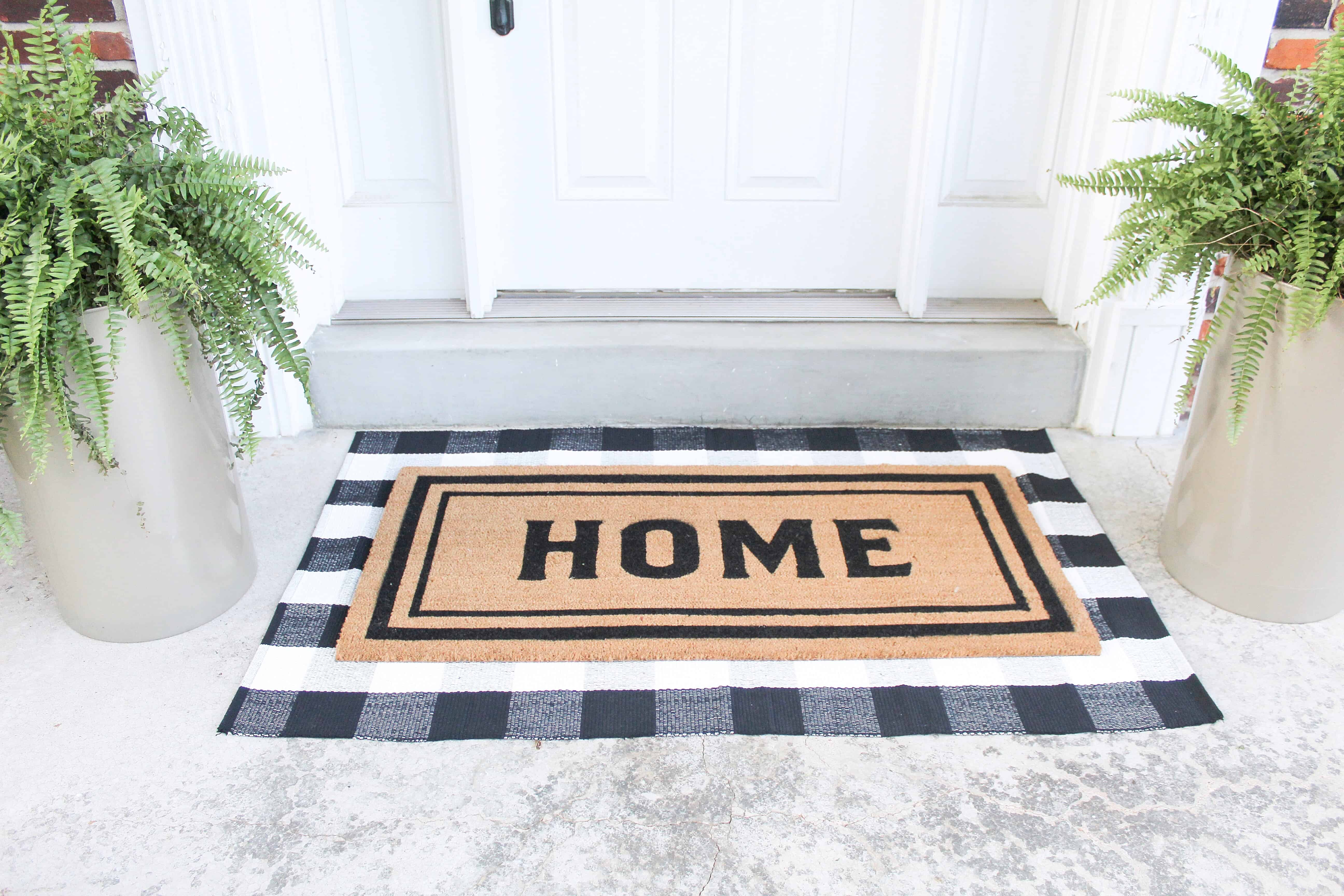 front porch with layered rugs | Trash Can Planter Hack