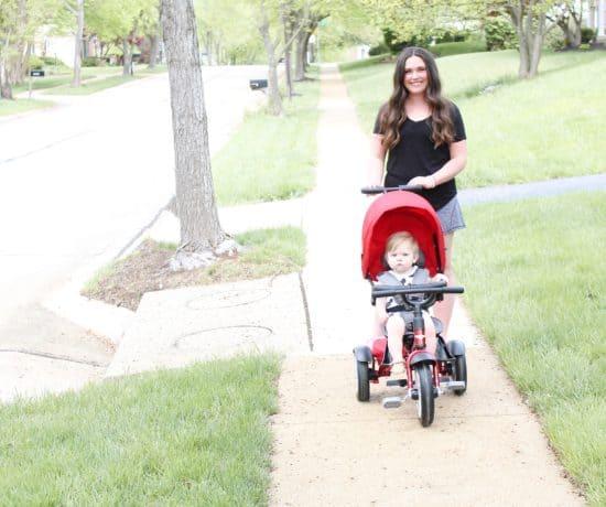 mom pushing Bentley trike on sidewalk