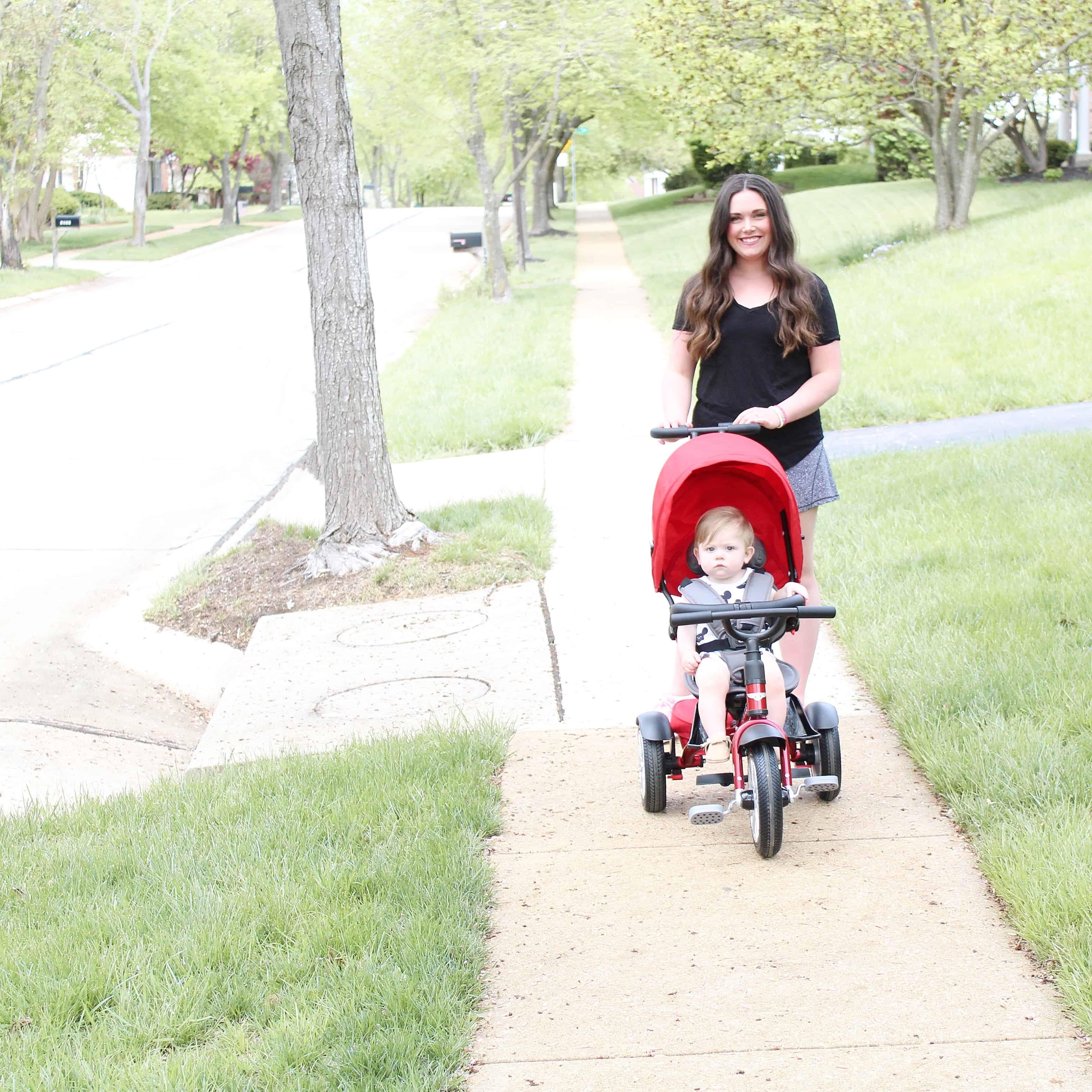 mom pushing Bentley trike on sidewalk | One Year Old Boy Gift Guide