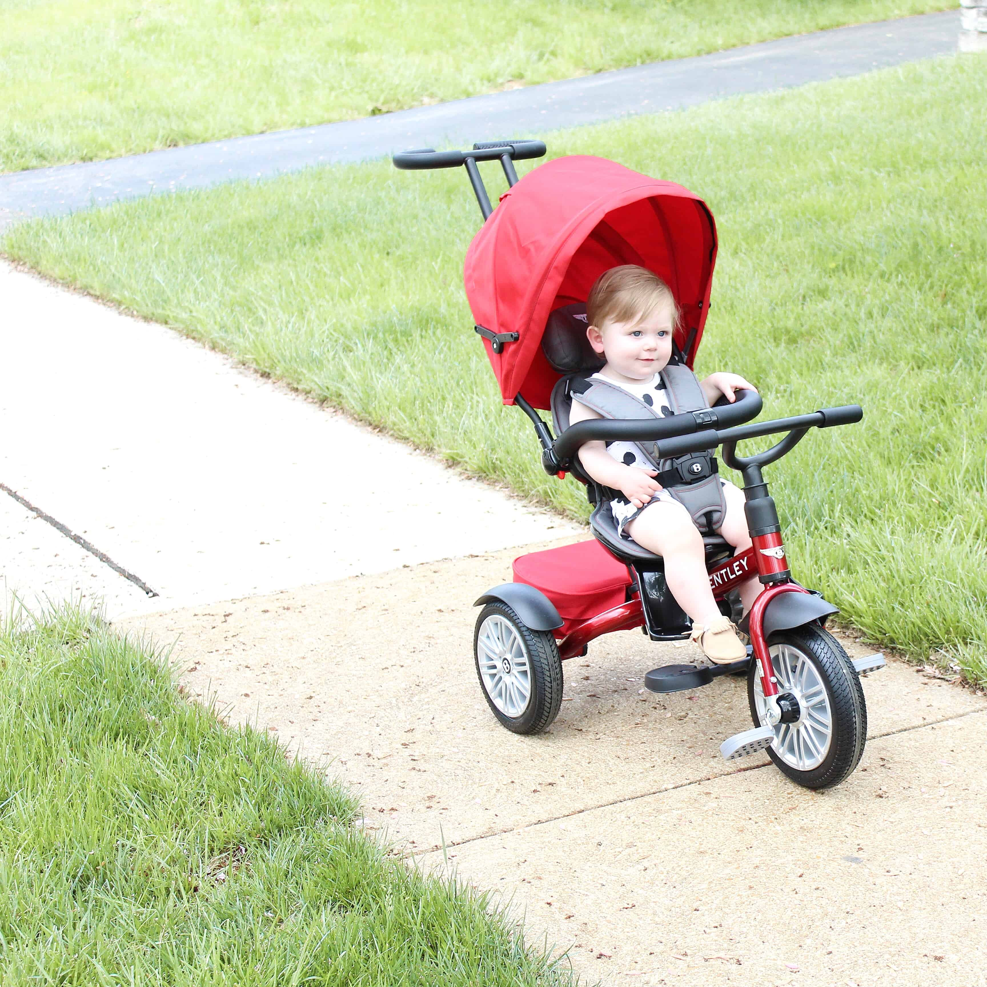 baby on red Bentley trike | One Year Old Boy Gift Guide