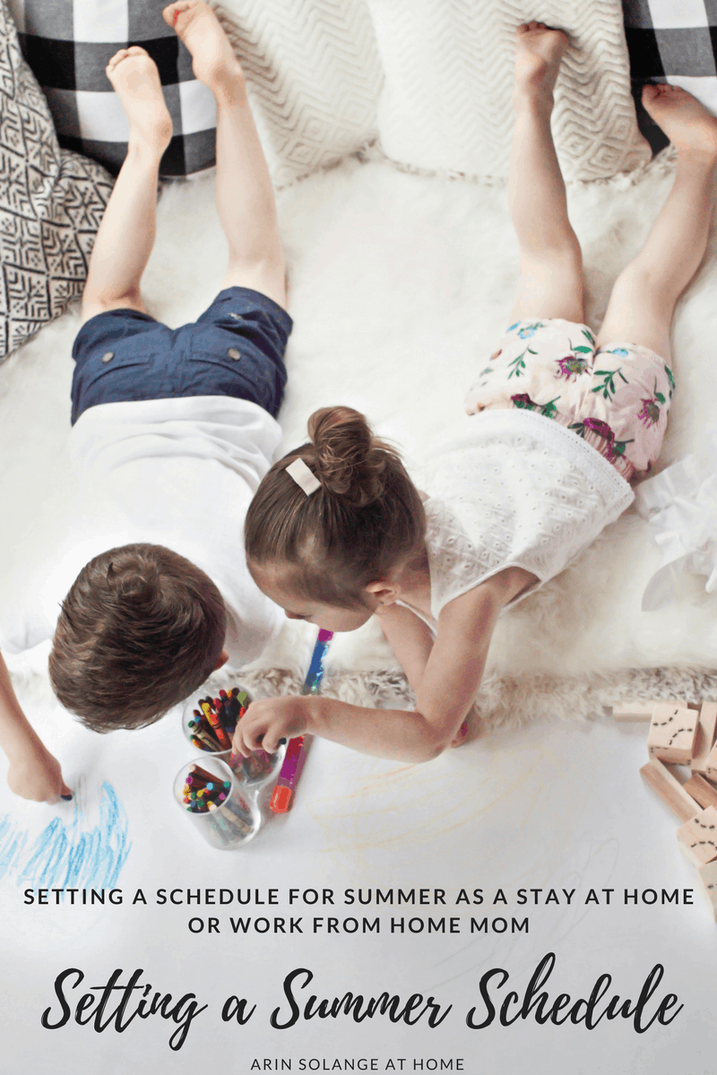 brother and sister laying down coloring | Creating a Summer Schedule