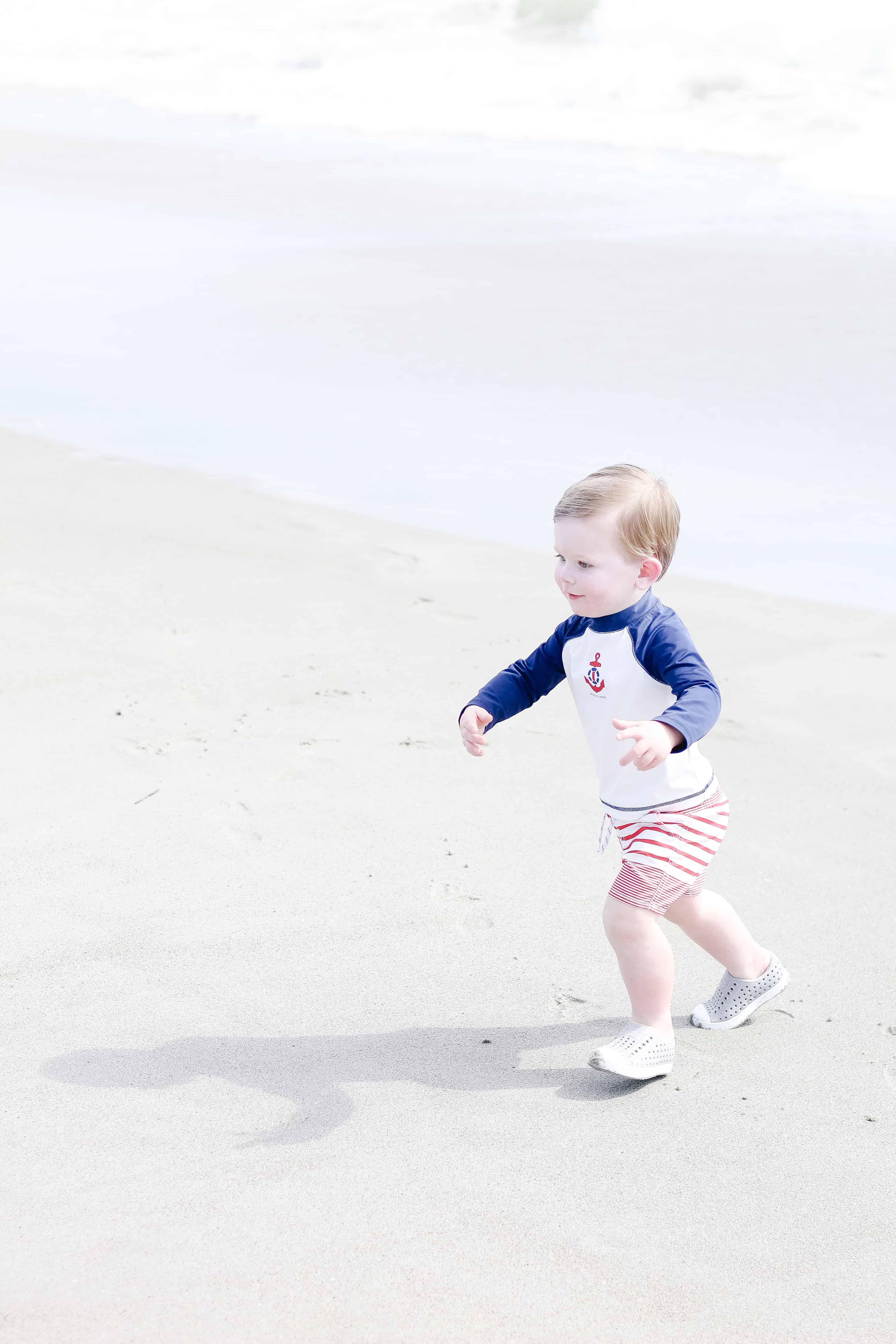 Toddler Boy running on beach