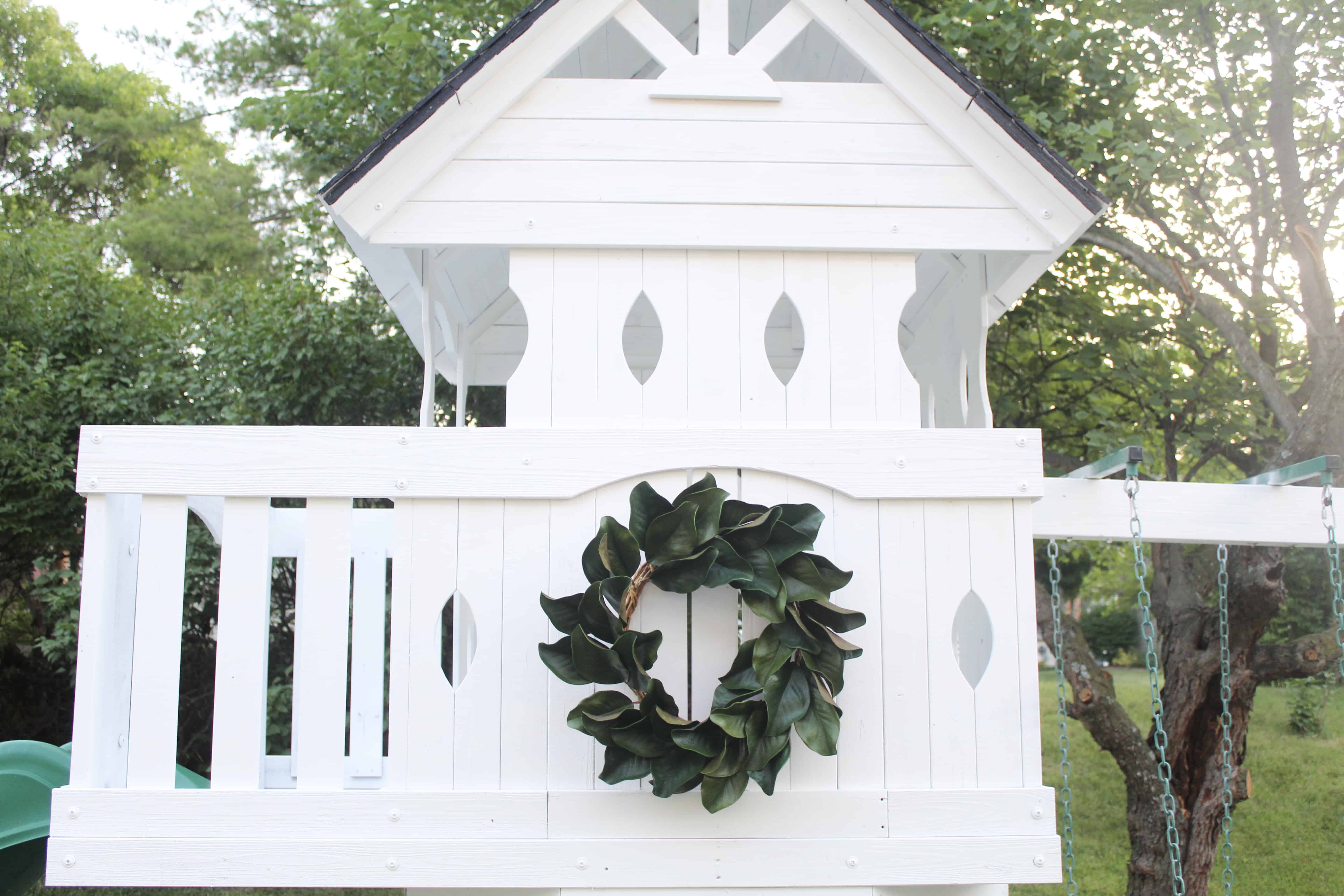 White swingset with magnolia wreath | DIY Swingset Makeover