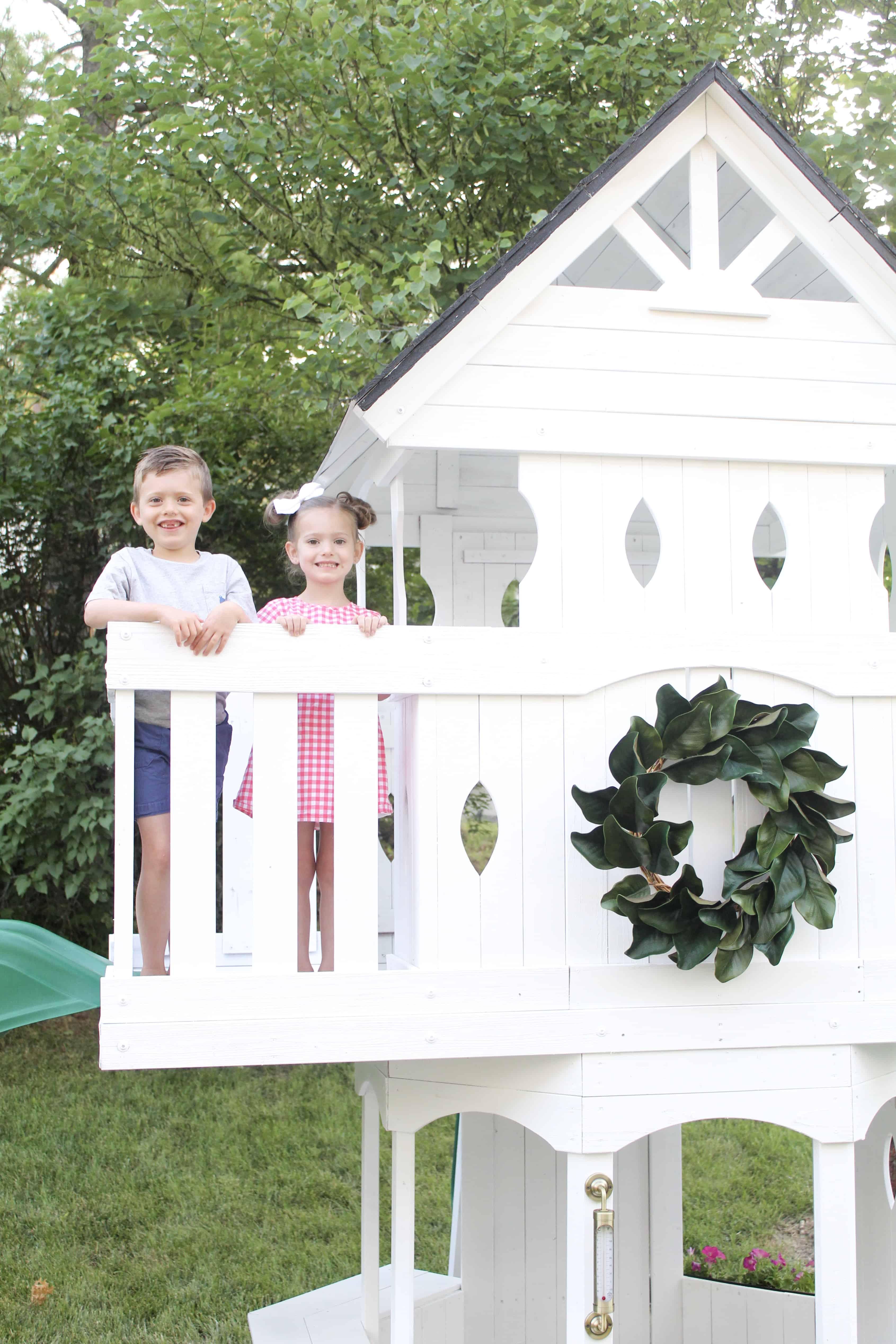Kids on white swingset | DIY Swingset Makeover