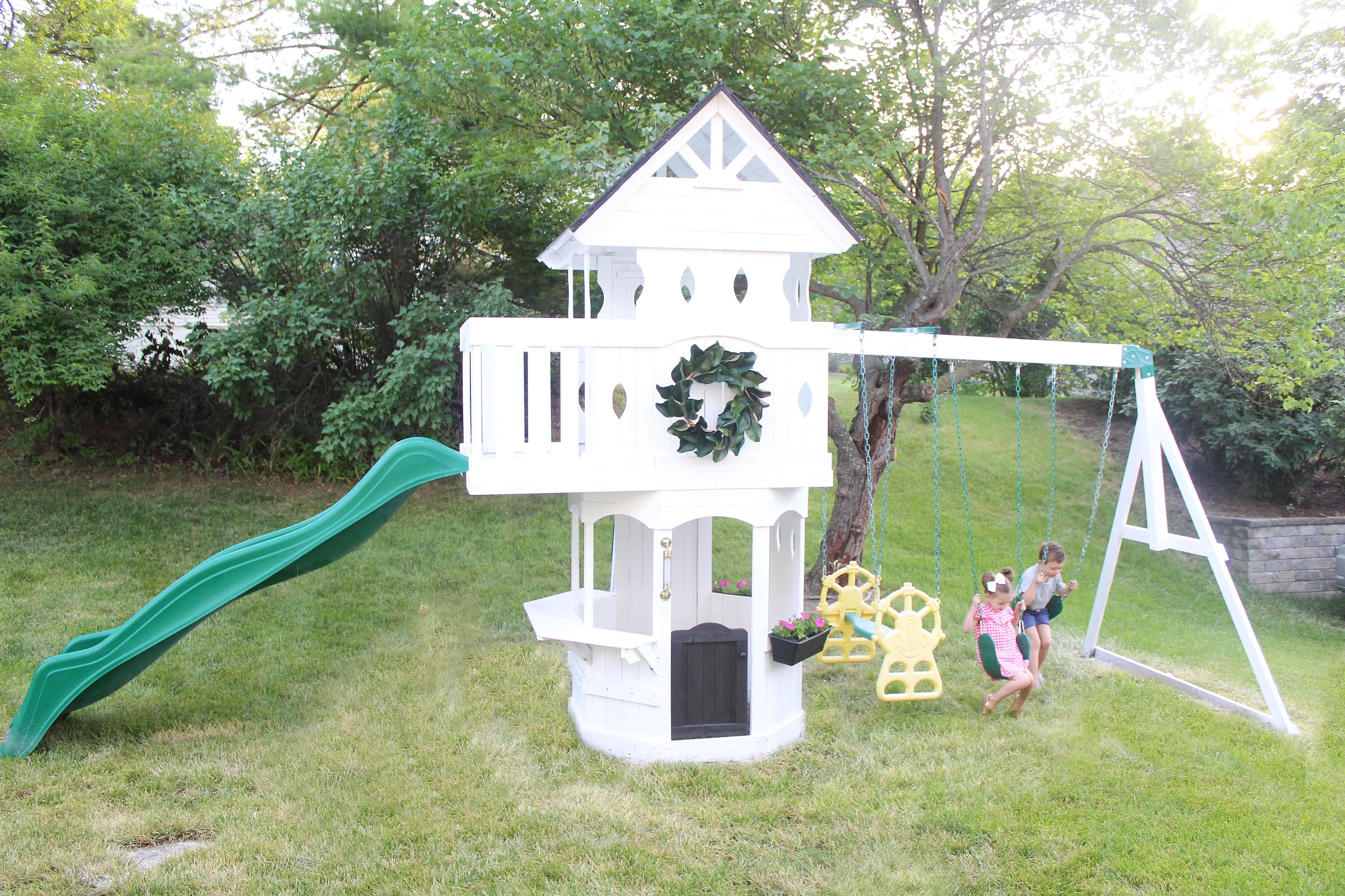 Kids swinging on DIY swingset | DIY Swingset Makeover
