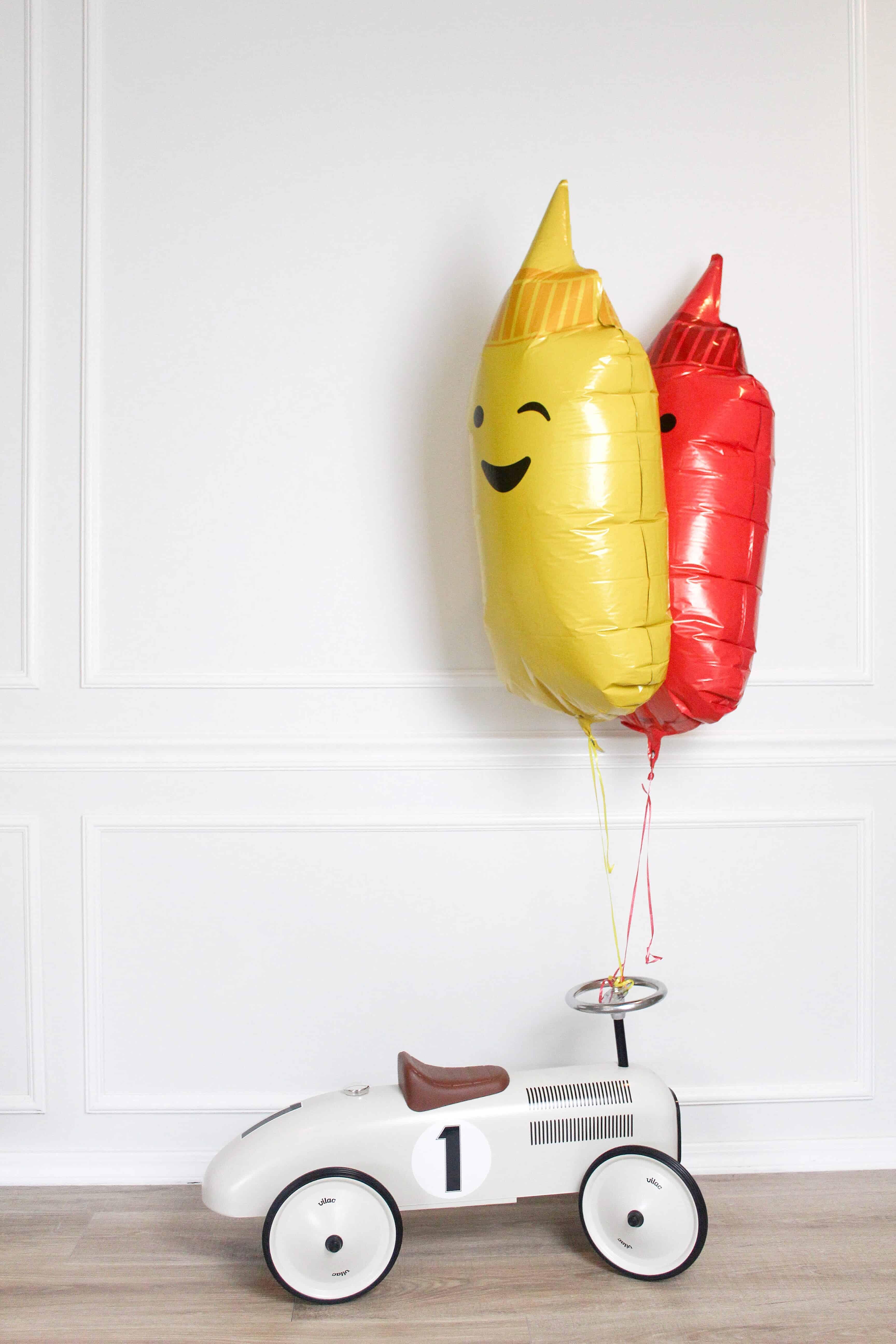 1 car with mustard and ketchup balloons