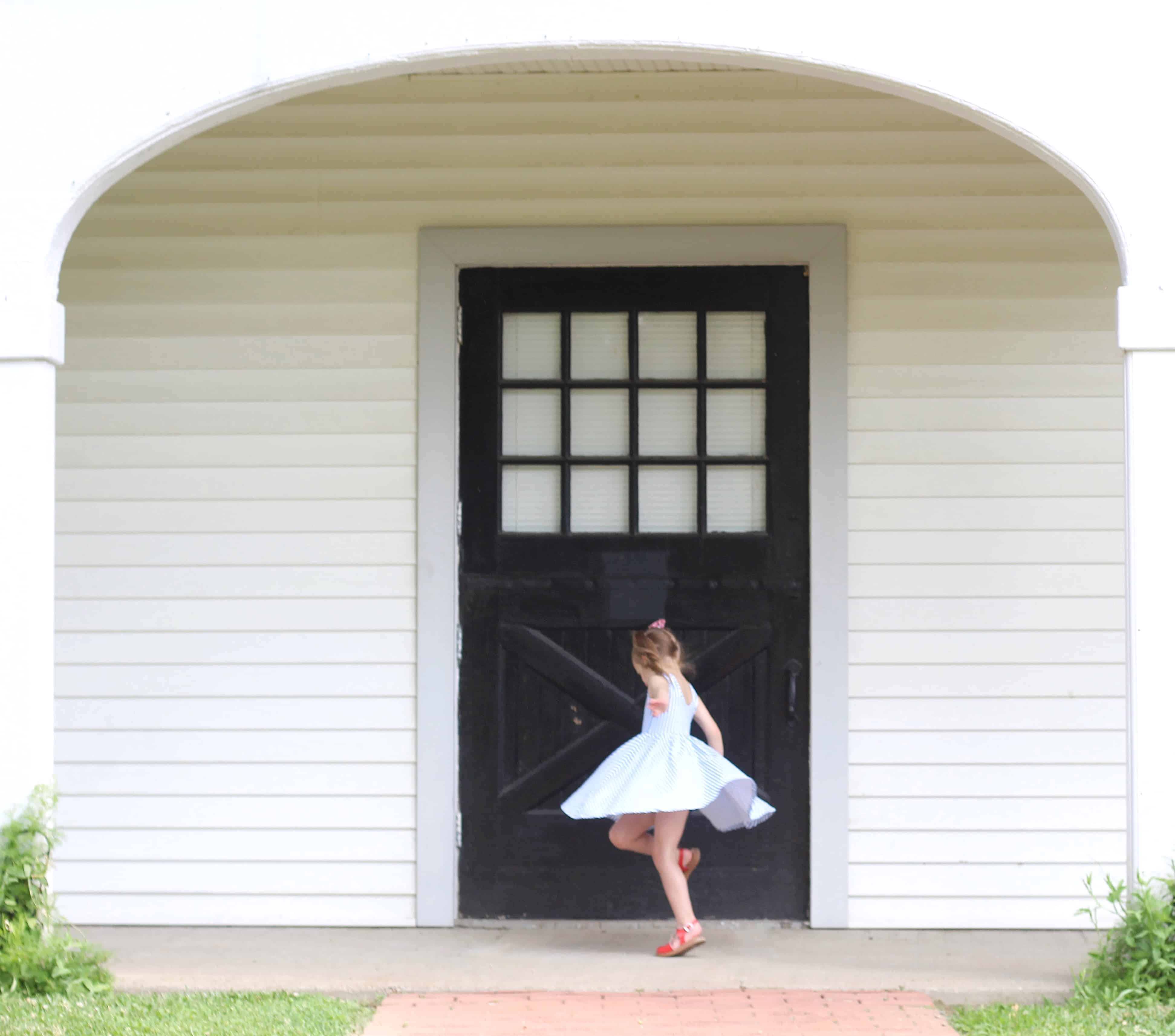 little girl twirling in Alice and Ames dress