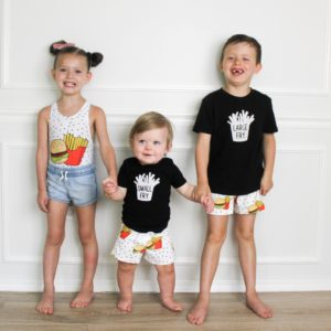 siblings in matching hamburger themed outfits