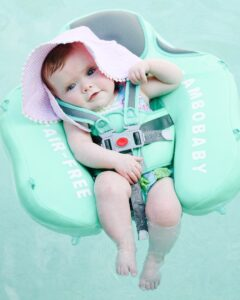 baby girl in pool float