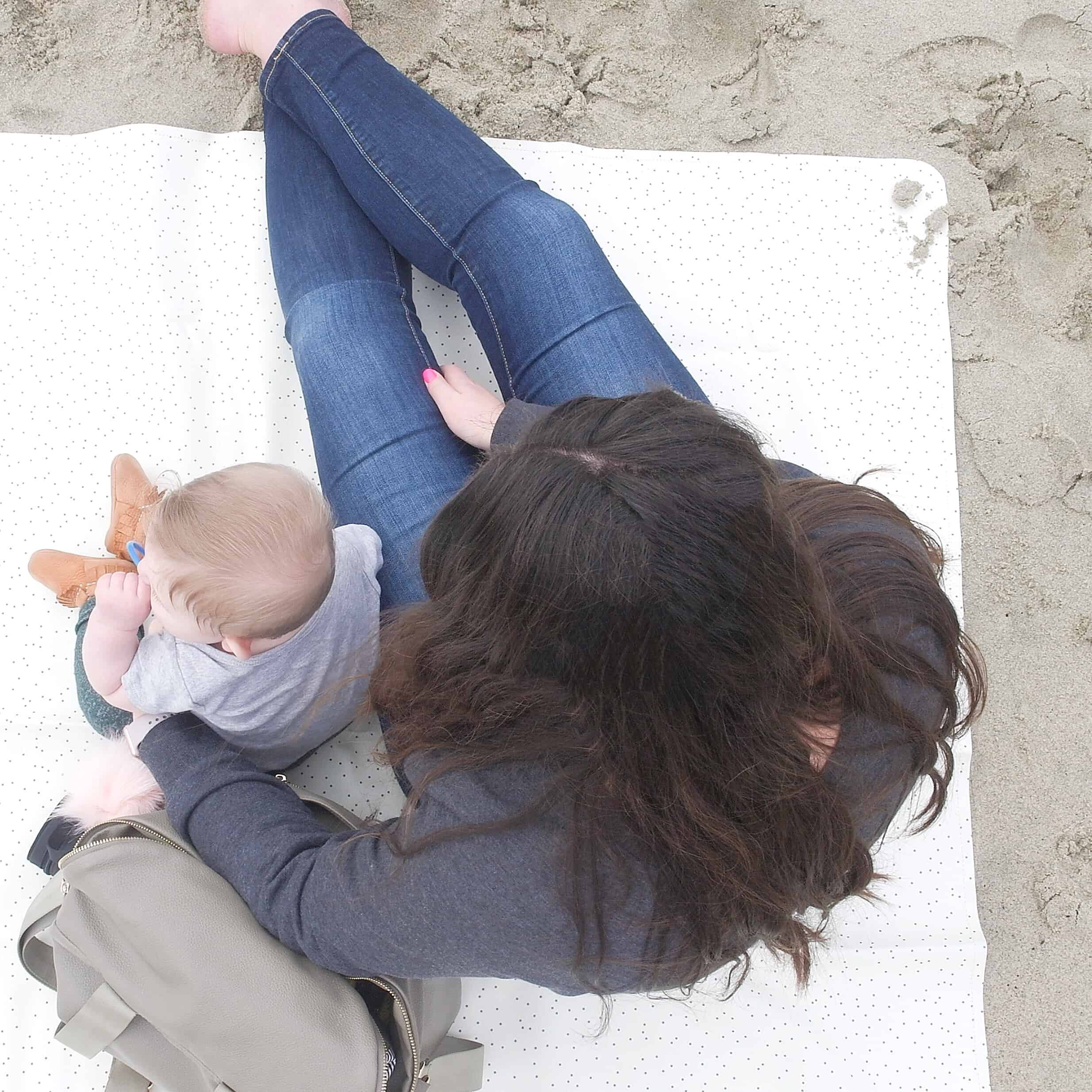 baby and mom on gathre mat at beach | Baby and Toddler Beach Must Haves