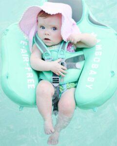 baby girl in mint pool float