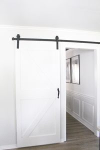 white barn door to dining room