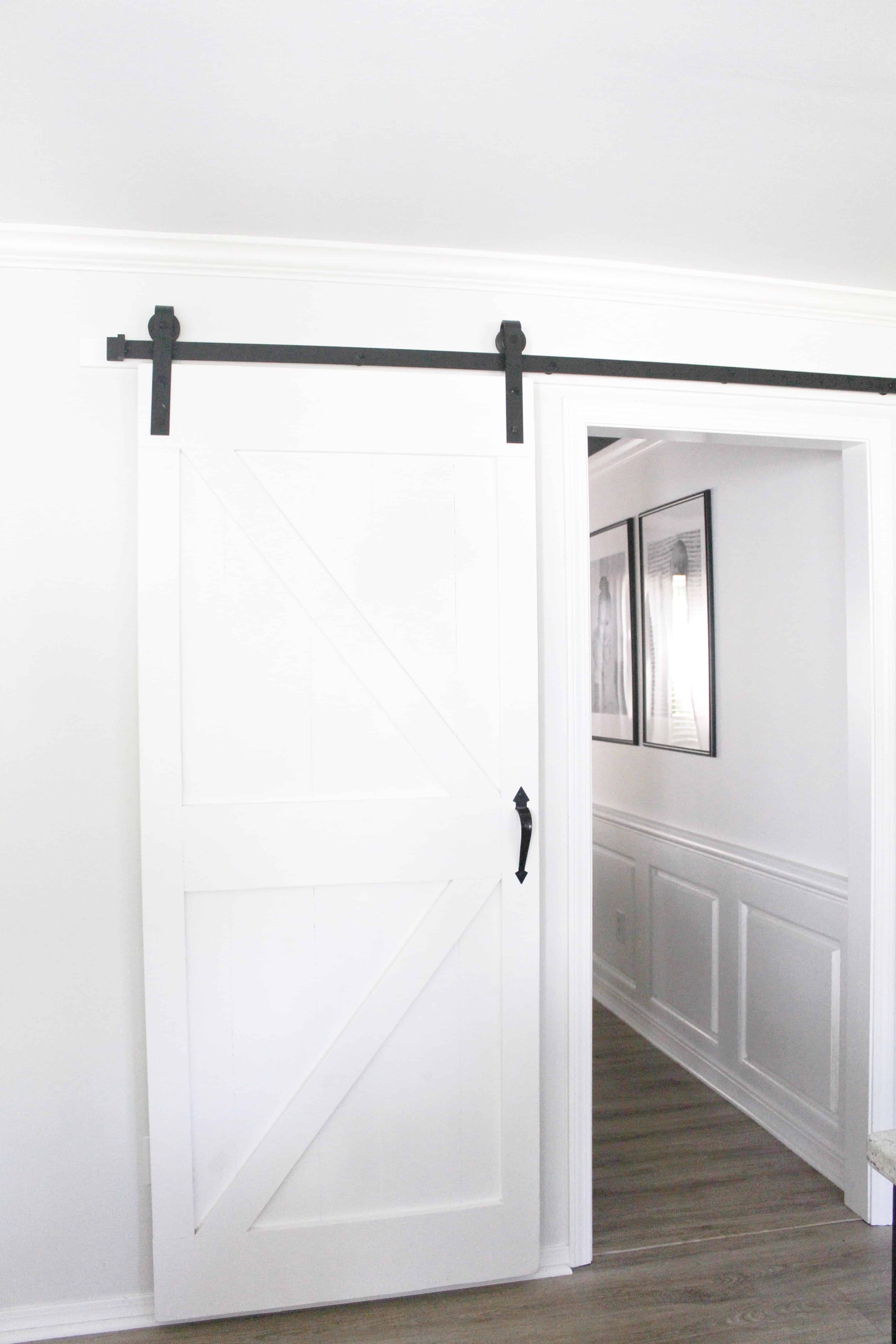 white barn door to dining room