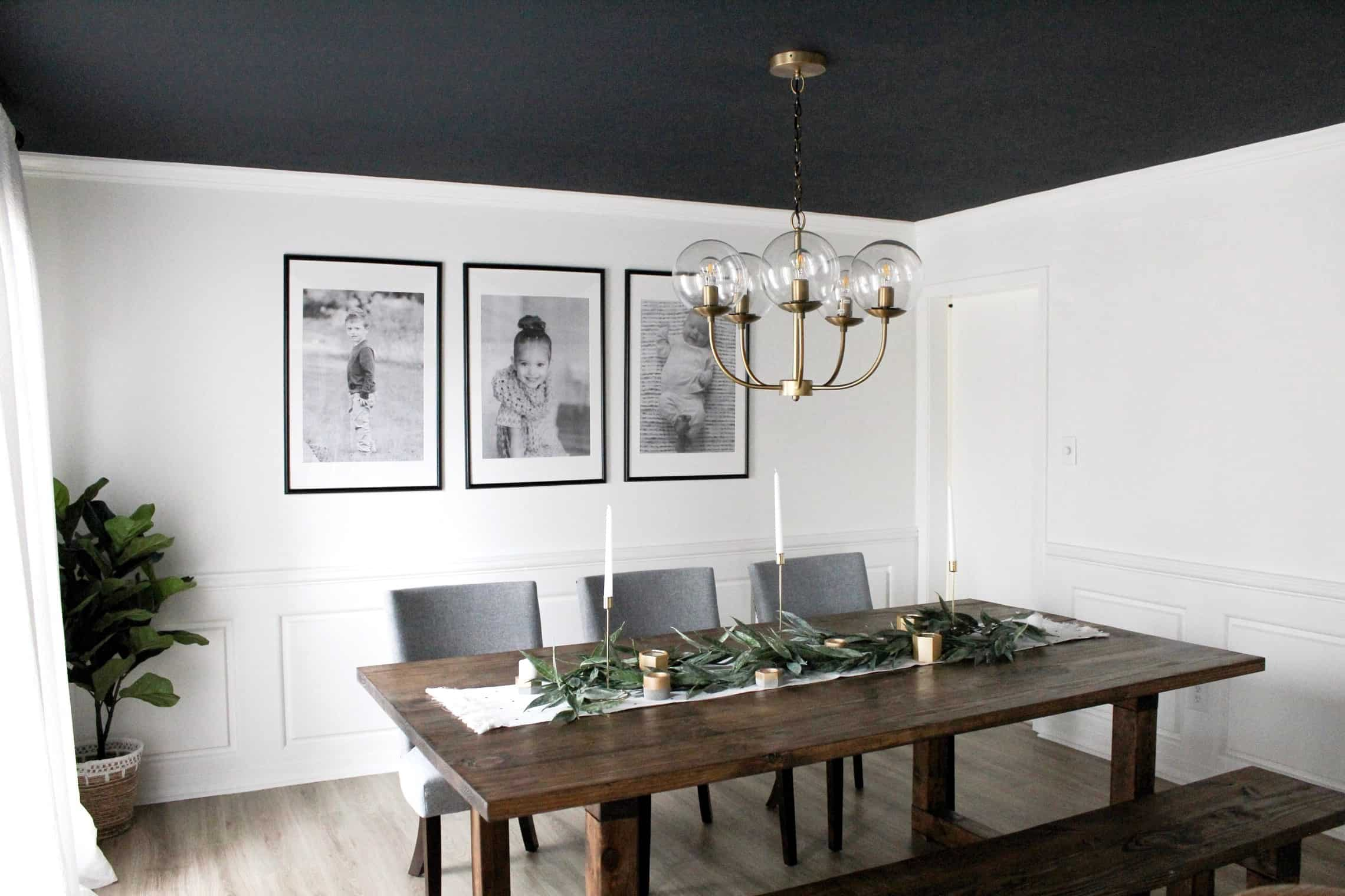 dining room with a dark ceiling