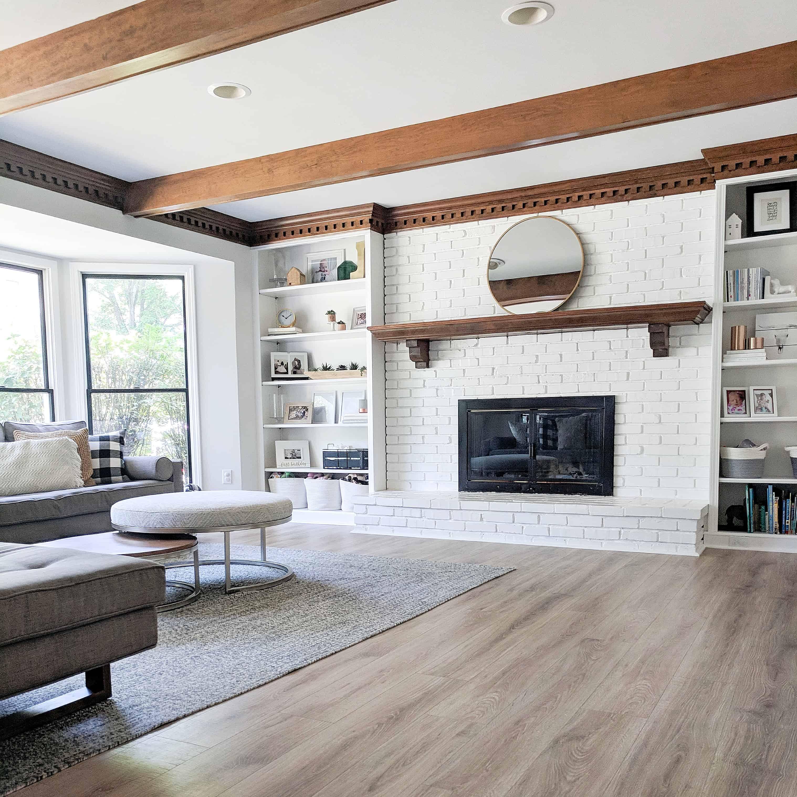 modern living room white white fireplace